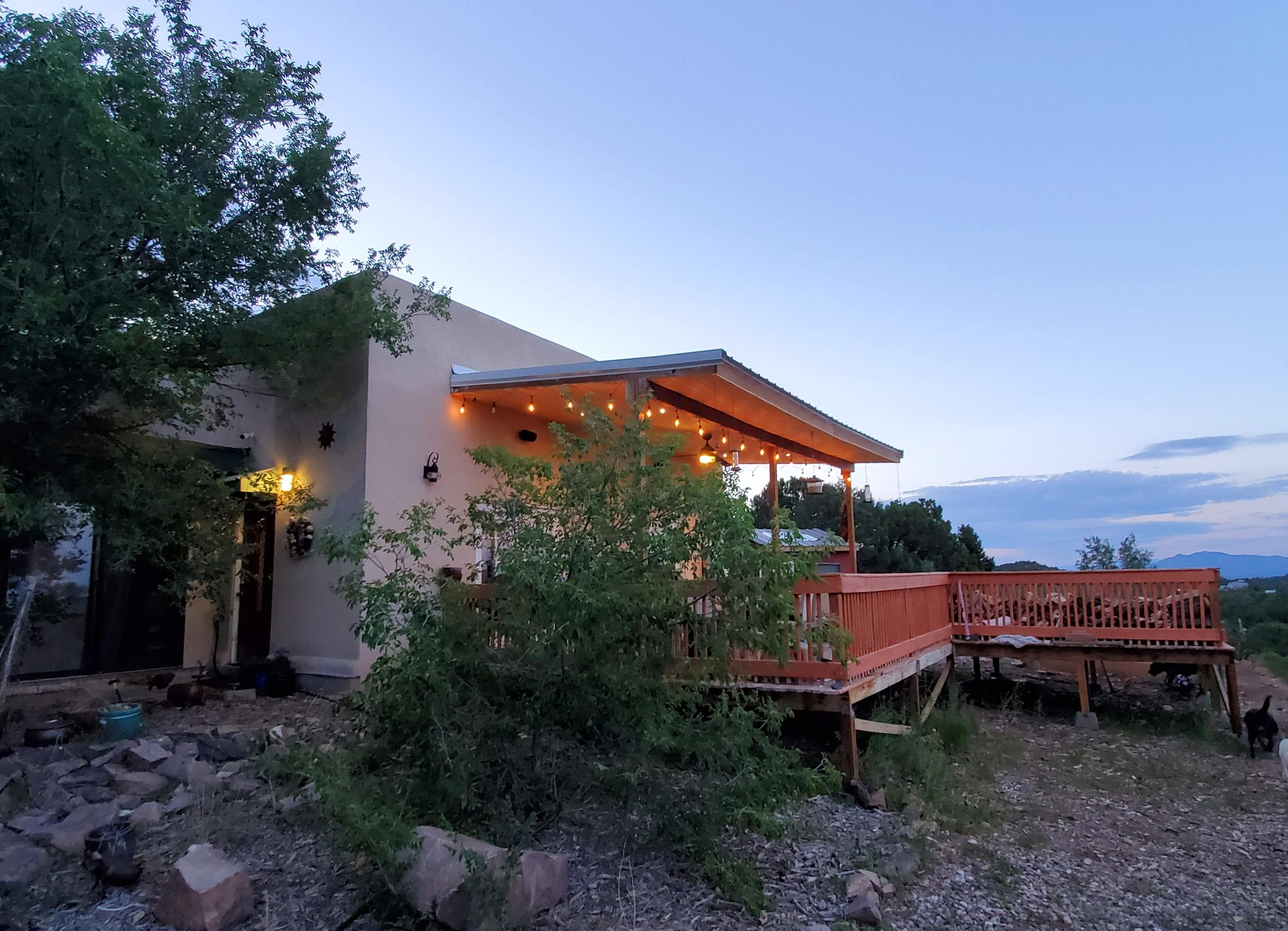 Dream of living in your own private mountain retreat with gorgeous views and plenty of outdoor living space, but with easy access to Albuquerque and all its amenities? If so, you'll love this home! This property is close to 6.5 acres making it extremely private, with panoramic views all the way from the Manzano mountains up to Santa Fe. Yet it's only 4 miles north of I-40, making an easy 20min commute into the city. Besides a spectacular location, this property boasts a 2350 sq ft home and a finished 3200sq ft shop, making it ideal for a business owner or for storing anything from RVs to boats to cars. You won't find anything else like it in the area!