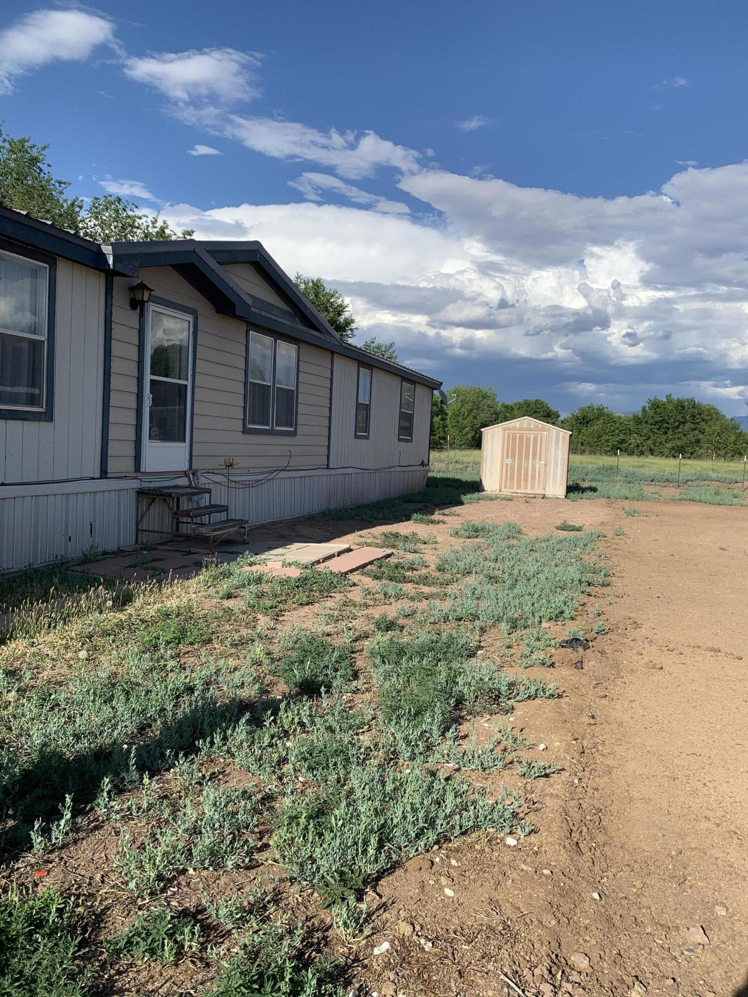 This listing will not last long!! The manufactured home is priced to sell, It features  4 bedrooms 2 baths with 2 living areas. It also has a big family kitchen, walk in closets and refrigerated air.  You get a country feel all while being close to stores and restaurants. Schedule your showing today!