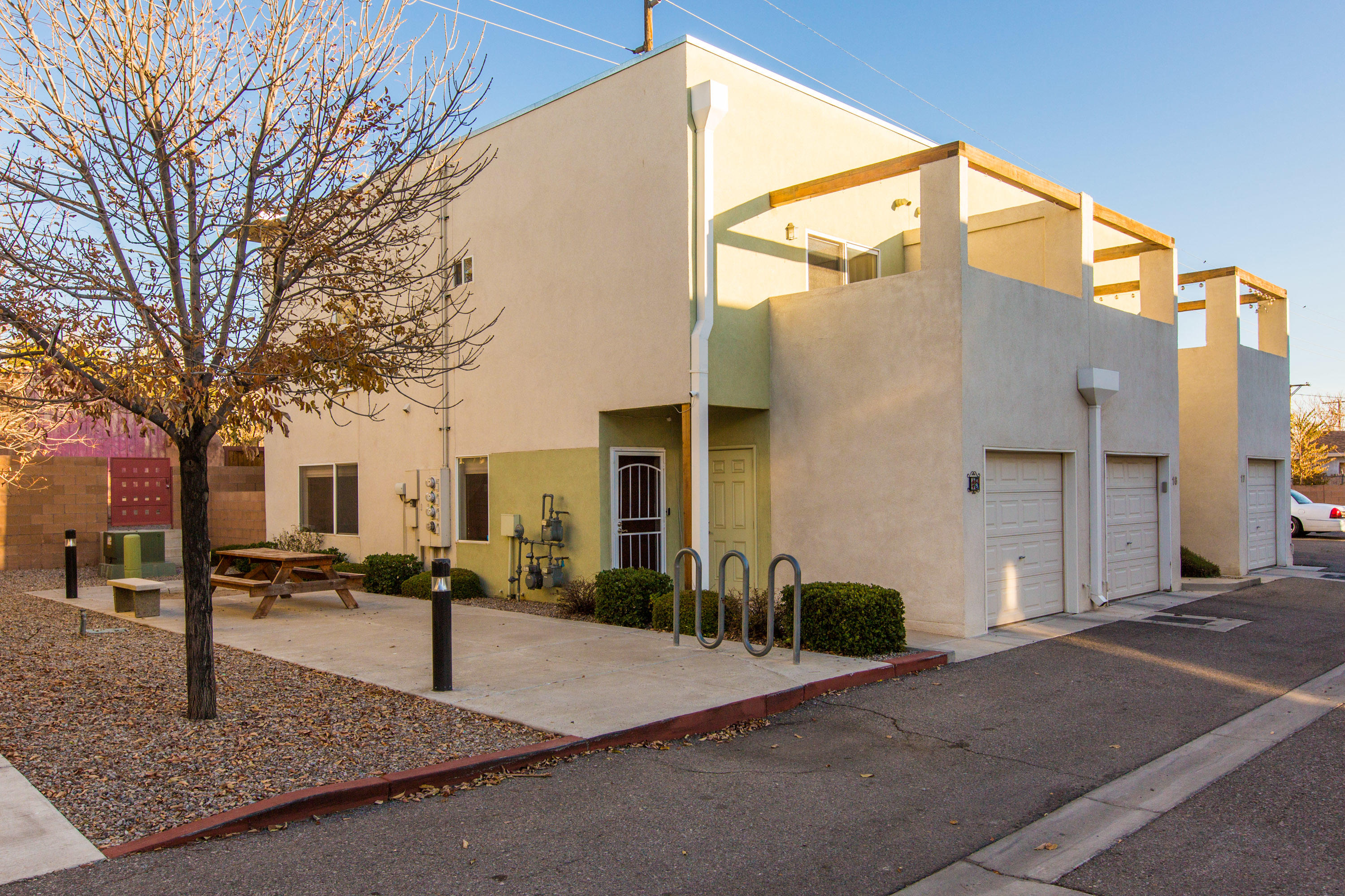 Light, airy, modern condo located near downtown/UNM/Nob Hill area. Fully equipped Kitchen. Bedrooms located upstairs with jack and Jill bath. Balcony off Owners suite. Private walled backyard. 1 car garage included. End unit, has large north facing window.