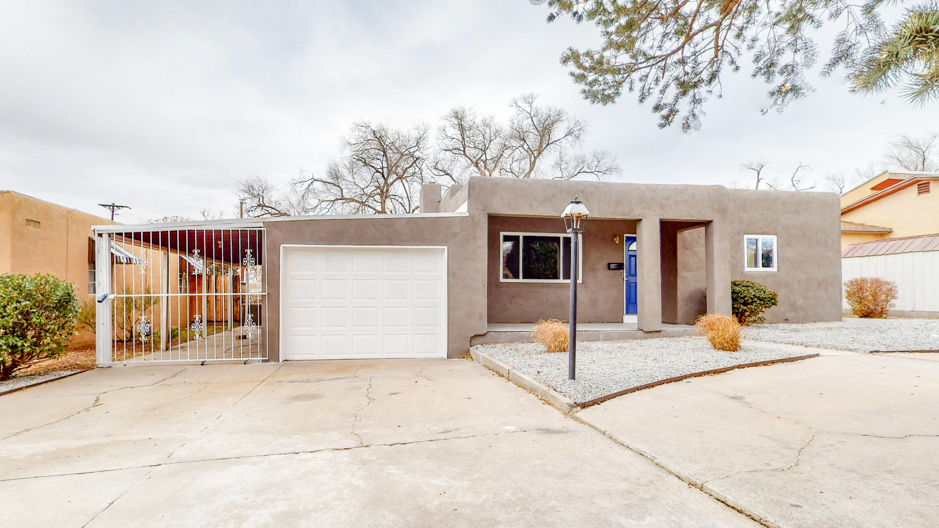Welcome to Albuquerques UNM south area! Conveniently located near UNM, Kirtland Air Force Base, the airport, and downtown... This charmer of a home is guaranteed too excite! This home boast all new xeriscape. New elastomeric stucco paint. New windows (2020)! New TPO roof (2020). Open concept living. Original restored hardwood floors. A brand new kitchen with stainless steel appliances, new cabinets quartz countertops and a showstopping backsplash (2020! Energy efficient ductless mini split's zoned privately for the ideal temperature for everyone in the house! A fully upgraded brand new bathroom (2020)... A massive backyard for every entertainers delight is sure to impress your guests. Not to mention one of the only FINISHED oversized two car garage is in the area!