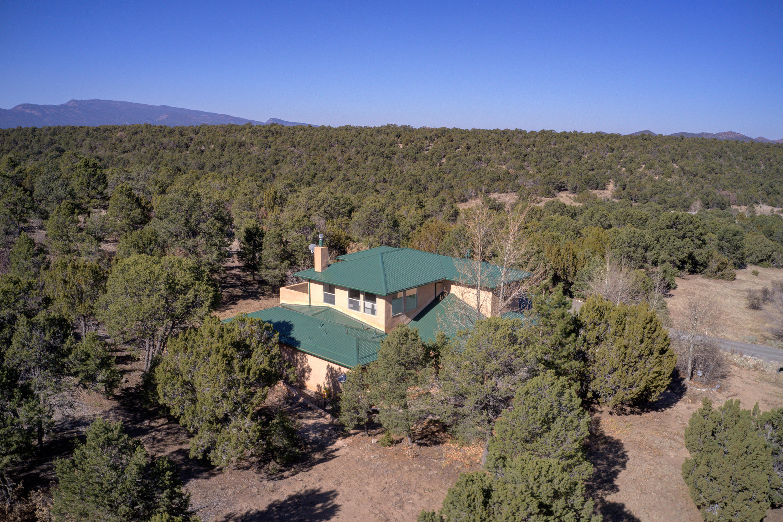 Nature Lovers Welcome!  Escape the city and live in this Beautiful Custom home in the coveted Woodlands Subdivision.  All of the convenience of living off the Highway (easy 20 minute commute to ABQ with little-to-no traffic), but yet still private and secluded without any of the noise!The home has already finished inspections and is just waiting for it's new owners.  New Roof, Gutters, and Downspouts. New Furnace.   Enjoy mountain living and  let your stress melt away in the dry/steam sauna. For those who enjoy wildlife, you couldn't ask for more: Hummingbirds in numbers you've likely never experienced! Deer, Fox, Turkeys, Weasels, and more have all been seen on the property.  There are  views in all directions and a particularly fantastic view of South Mountain from the property.