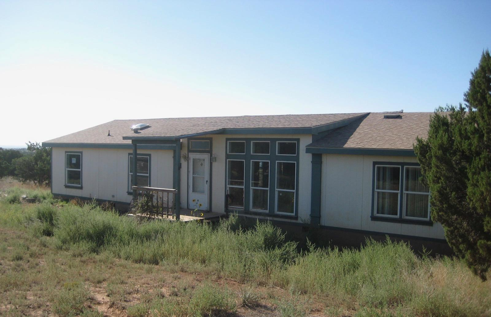 Welcome to quiet country living. This manufactured home features 3 bedrooms and 2 baths. Enjoy relaxing in the large living room or eating in the dining room. Ideally situated close to shopping, parks, schools and all the amenities of the city. Only a 30-minute commute to Albuquerque or about an hour to Santa Fe. DON'T MISS THIS ONE!!!