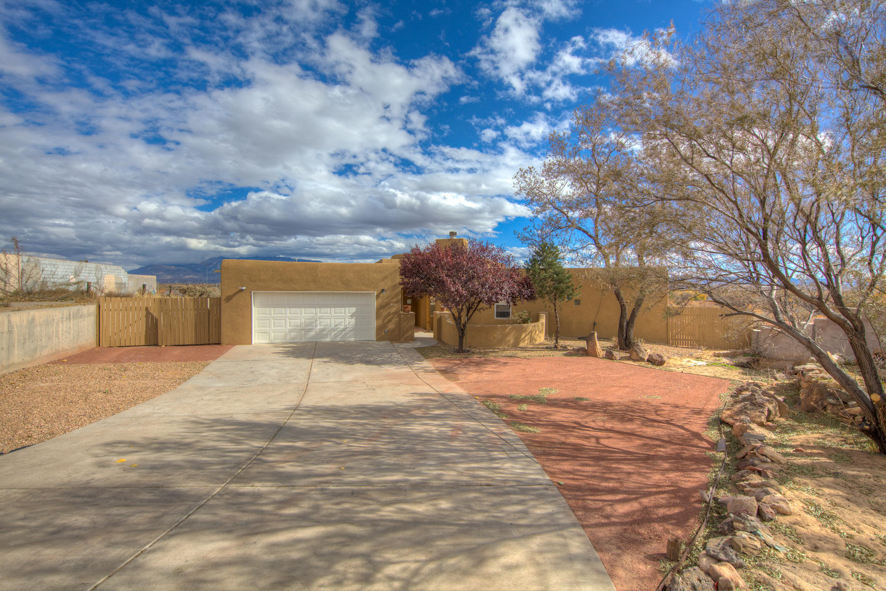 Stunning Views of Rio Grande and Sandia mountains. Enjoy this phenomenal property. Complete remodel with beautiful finishes. Master suite has his her baths. Open kitchen with sweeping views. Lots of storage and secondary rooms are good sized. This home is a must see.