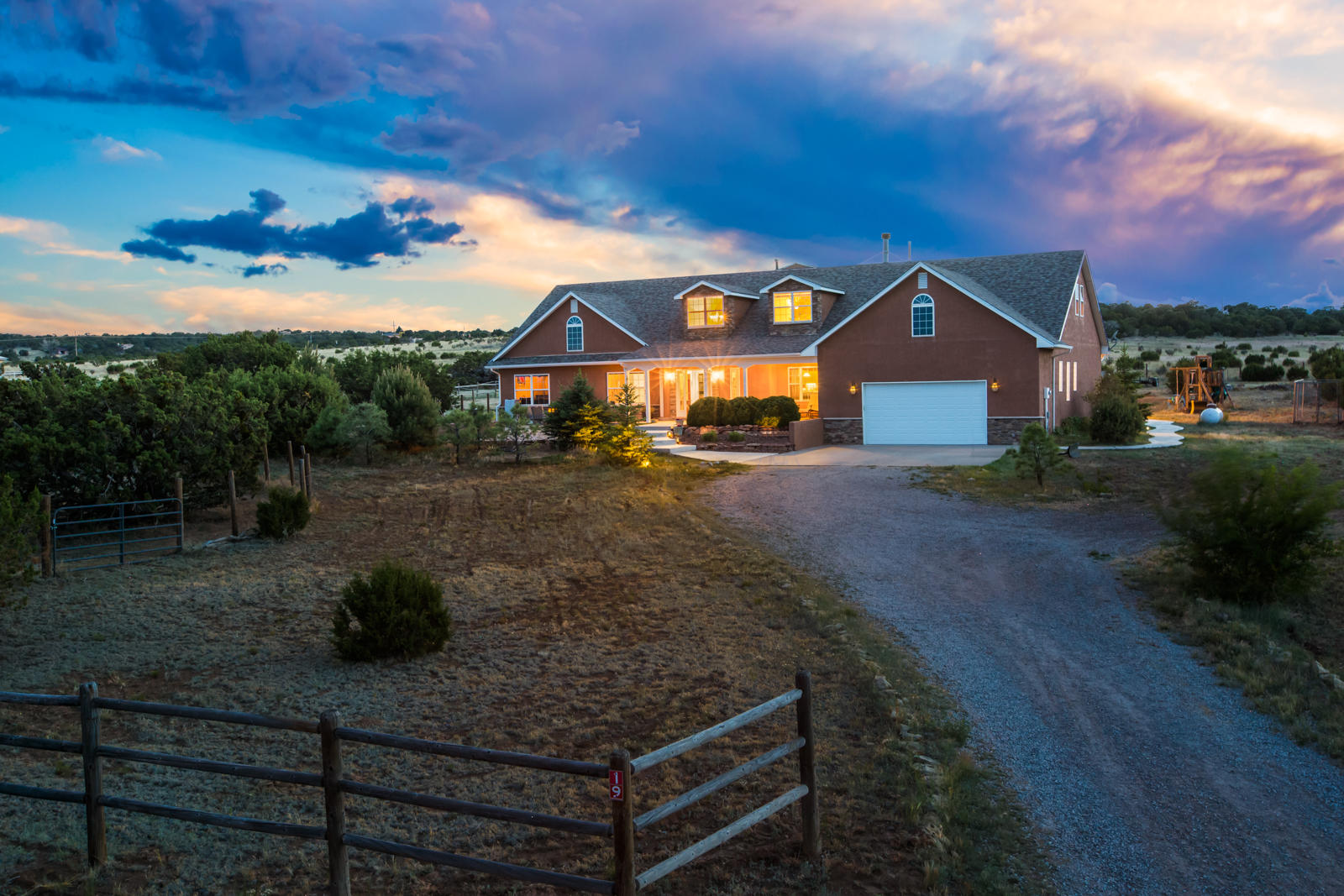 Come take a look at this beautiful mountain home! All the amenities you need on 2.5 acres of land that backs open space so no one will be building west of you. This house boasts wood floors, 2 furnaces, a wood stove, tandem 3 car garage with very high ceilings, brand new 100 MPH shingled roof, and stonework throughout. Enjoy a quiet evening or have a party on the front large entertaining area. This house has tons of room including office spaces upstairs and two large rooms that can be used for game rooms, theater rooms, or even a home gym. This home has so so much to offer there is not enough room to list it all.
