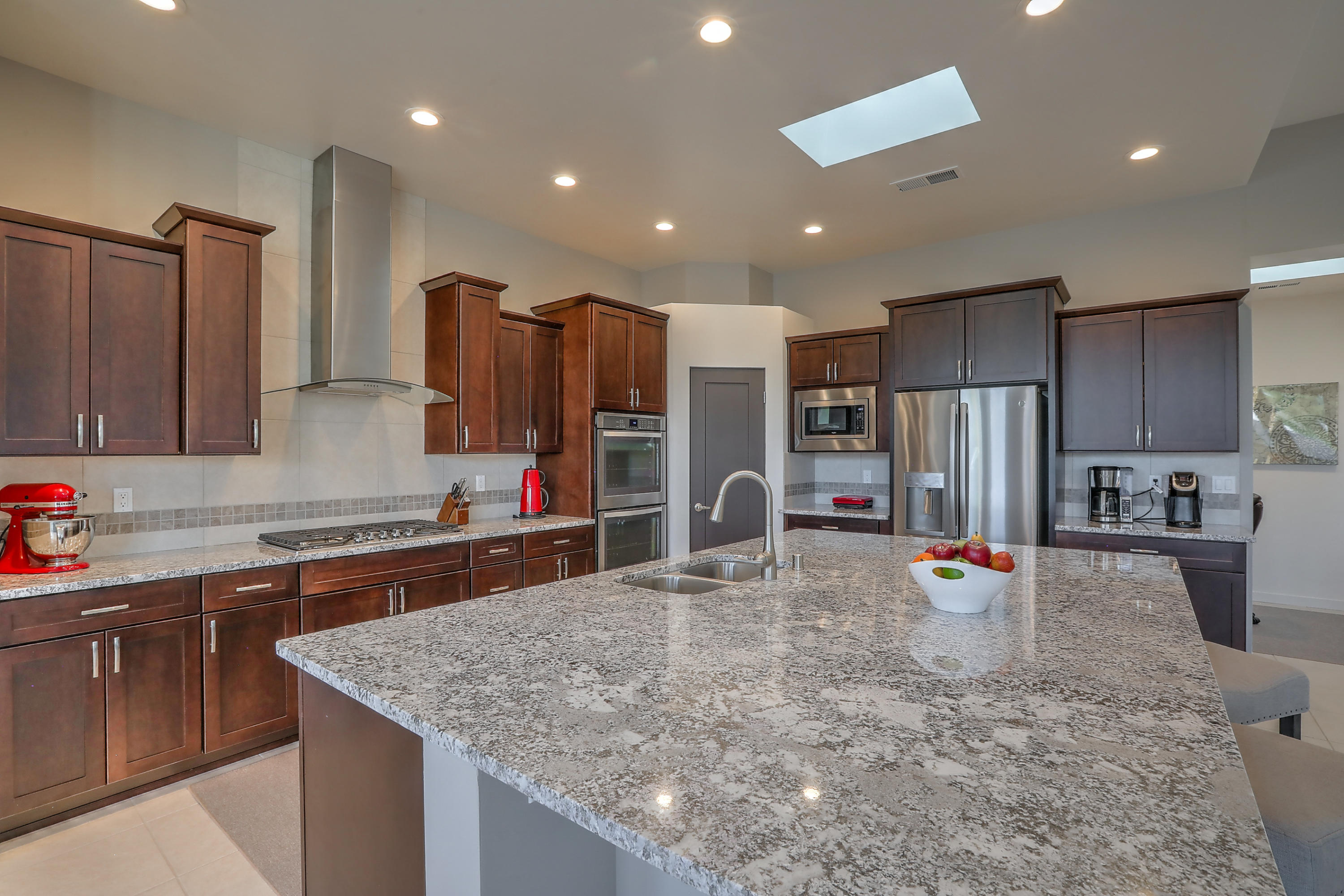 """2018 Scott Patrick contemporary style Home located in a Gated Community, North Star, Desert Ridge & La Cueva districts! Seller relocating January so there is time to get yours sold or simply plan for a fresh start in 2021! You will love the open, light filled home, raised ceilings, clean lines & Chic architectural finishes - ceiling treatments, custom lighting, granite throughout & sleek tiled backsplash. Separated owner's suite, large rooms, 2 walk-in closets, full baths w/double sinks, spacious living/kitchen a"""" great for entertaining, living/dining combo w/cozy fireplace & a perfect tucked in study w/built in desk, cabinetry & counterspace! Private, easy-care yards relax by the firepit, evergreen turf lawn & expansive covered patio, it's everything you want in your ABQ Dream Home."""