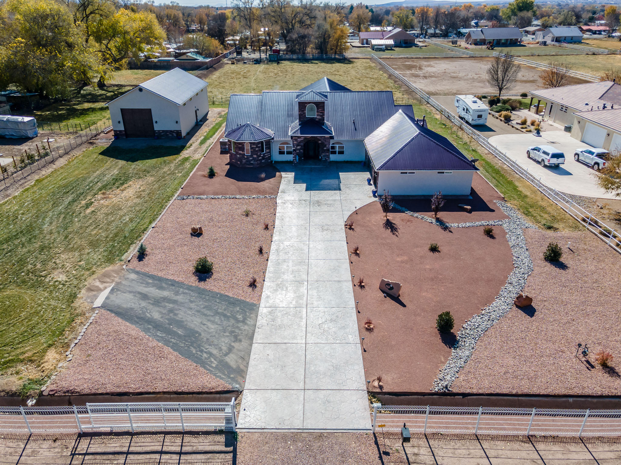 This absolutely stunning custom in the south valley is on 2.25 irrigated acres.   The gated and fully fenced property invites you into the grand entry with atrium foyer. The open floor plan, offers, formal living room, formal dining room, gathering room, and game room for entertaining.  Outdoor tiled living space offers additional gathering in front of the wood burning fireplace and gas stub out for outdoor living. Grand master bedroom with sitting area, soaking tub, inifinity dual shower, and large walk in closets are an added plus. The  2 mini masters offer private baths, walk in closets, and are oversized for added tranquility. The office/study bonuses as a 4th bedroom with walk in closet as well. Did I mention the sound proof wall throughout for those working and studying from home.