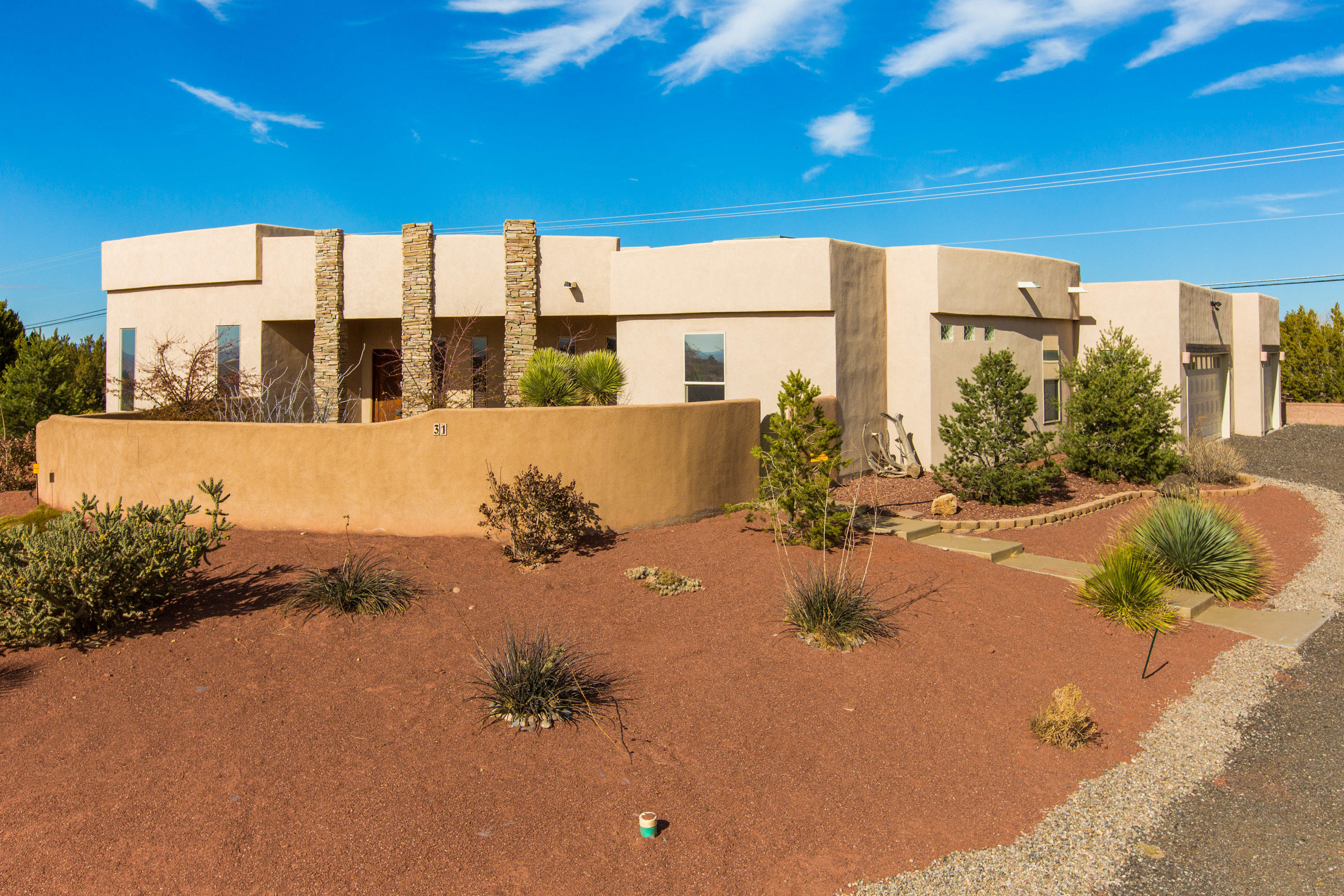 This stunning Placitas home has a perfectly designed floor plan. Step through the private courtyard and through the front door to vaulted ceilings, an open kitchen with sliding doors that open to the backyard, and a grand living room with stone fireplace. The owner's suite is on the opposite wing of other bedrooms, and has a small room off it (not included in the # of bedrooms) that is perfect for an office, yoga space, or hobby room. The owner's suite is spacious and has a gorgeous bathroom with walk-in shower. Updates/Features: beautifully remodeled kitchen; newer tile throughout living areas; brand new carpet in all bedrooms; 3-car garage with epoxy floors; tankless hot water heater; custom window treatments, and plenty more! Quick access to I-25. Don't miss this one- it's SPECIAL.
