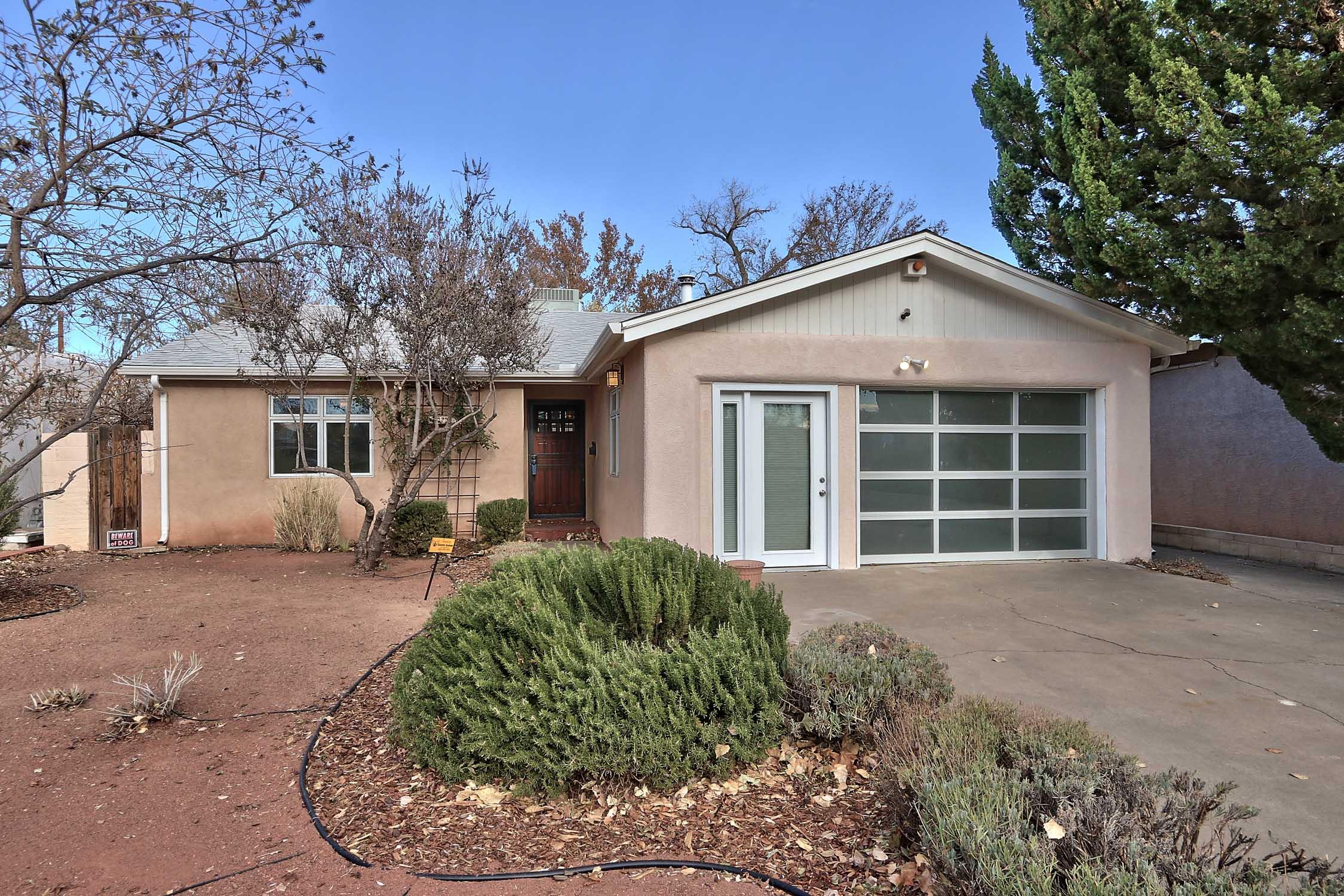 Charming Downtown Home, freshly painted. Steps from the Albuquerque Country Club.   Two generously sized bedrooms, 2 baths and lots of flex space in the finished garage.  Beautiful Kiva fireplace in the living room, SS appliances, Lots of light through out.  Low water low maintenance landscaping. Appliances convey'' As Is'' no warranty conveyed or implied.  Great opportunity to live in the Country Club. Home is move in ready. Roof is a few months old, Thermal pane windows, stucco has insulation. Come see it soon. Floor Plan available. Price correction reflects actual sq. ft.
