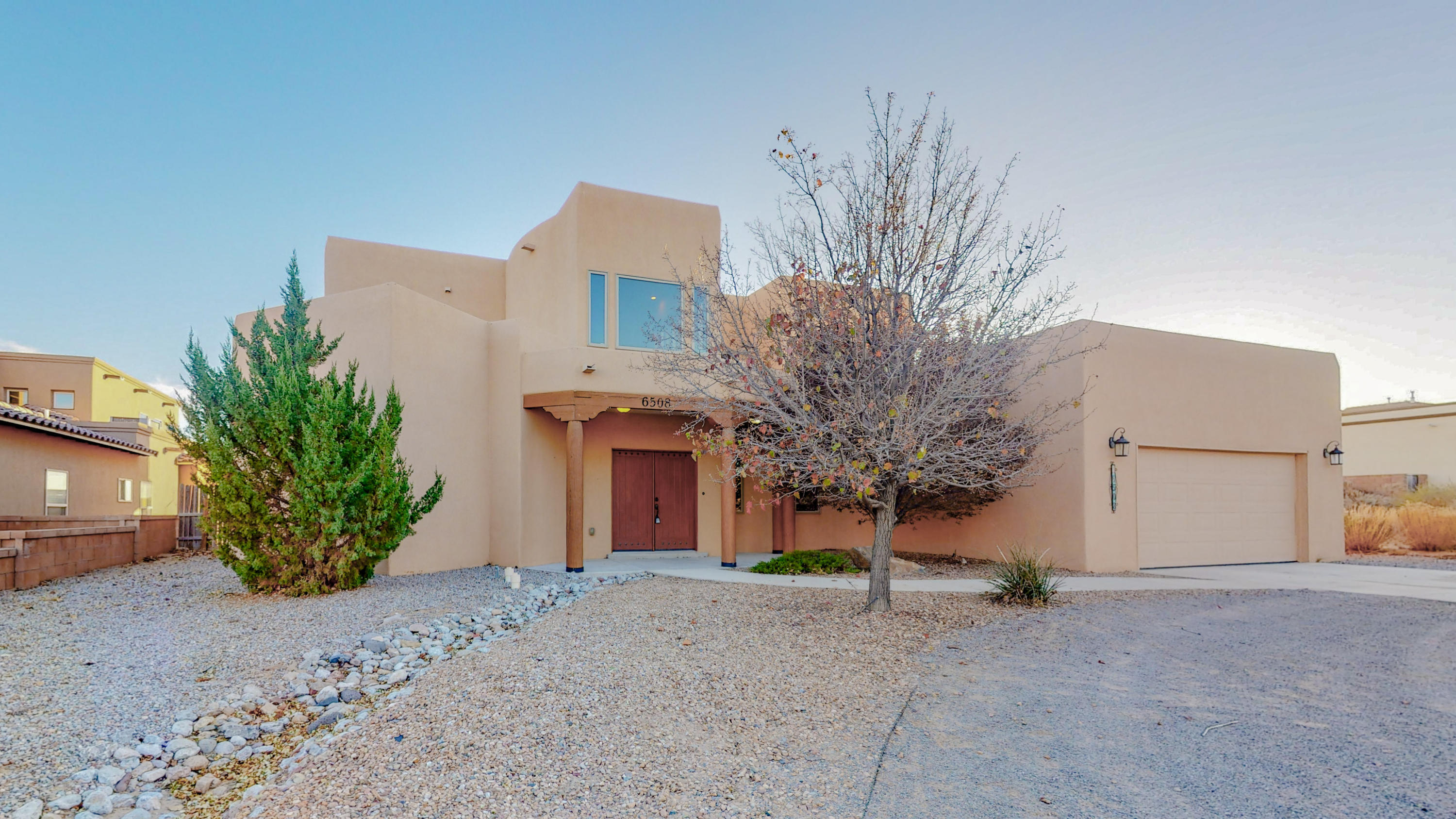 Beautiful custom home just became available for sale in the Vista Entrada area of Rio Rancho, NM. Features include: **NEW PAINT AND CARPET THROUGHOUT**Open Living Area with Fireplace**Master Bedroom and Den Downstairs**Loft and 3 Bedrooms/2 Bathrooms Upstairs**Jack & Jill Bathroom**Real Wood Doors Throughout**Dual Zone Refrigerated Air Conditioning**Balcony Upstairs**Large Covered Patio**3 Car Garage (Tandem Bay)**Epoxy Garage Floor**Large 1/2 Acre Lot**Close to Schools, New Shopping Centers and Restaurants**