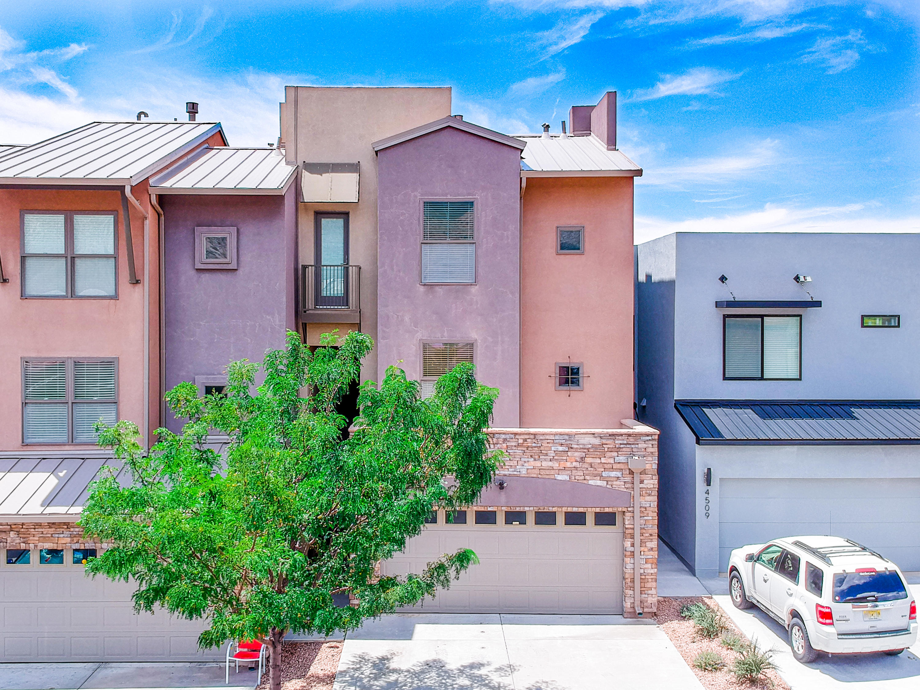 Unique residential elevator! Architecturally interesting in & out. Premier NE heights location is close to in-demand schools, shopping, dining, & hiking. Certified to Build Green NM Silver standards & loaded with features you expect of fine homes. Kitchen is finished with energy-efficient stainless steel appliances, tasteful tile, & granite countertops. Move yourself & things easily between levels in custom & unique residential elevator. Well-thought floor plan situates bedrooms privately & with access to sky decks & a balcony to enjoy our NM outdoors. Come see this efficiently constructed Parade of Homes award winner. AH...comfy year round with refrigerated air, furnace installed in insulated space, & tankless water heater. The list goes on; take a look!