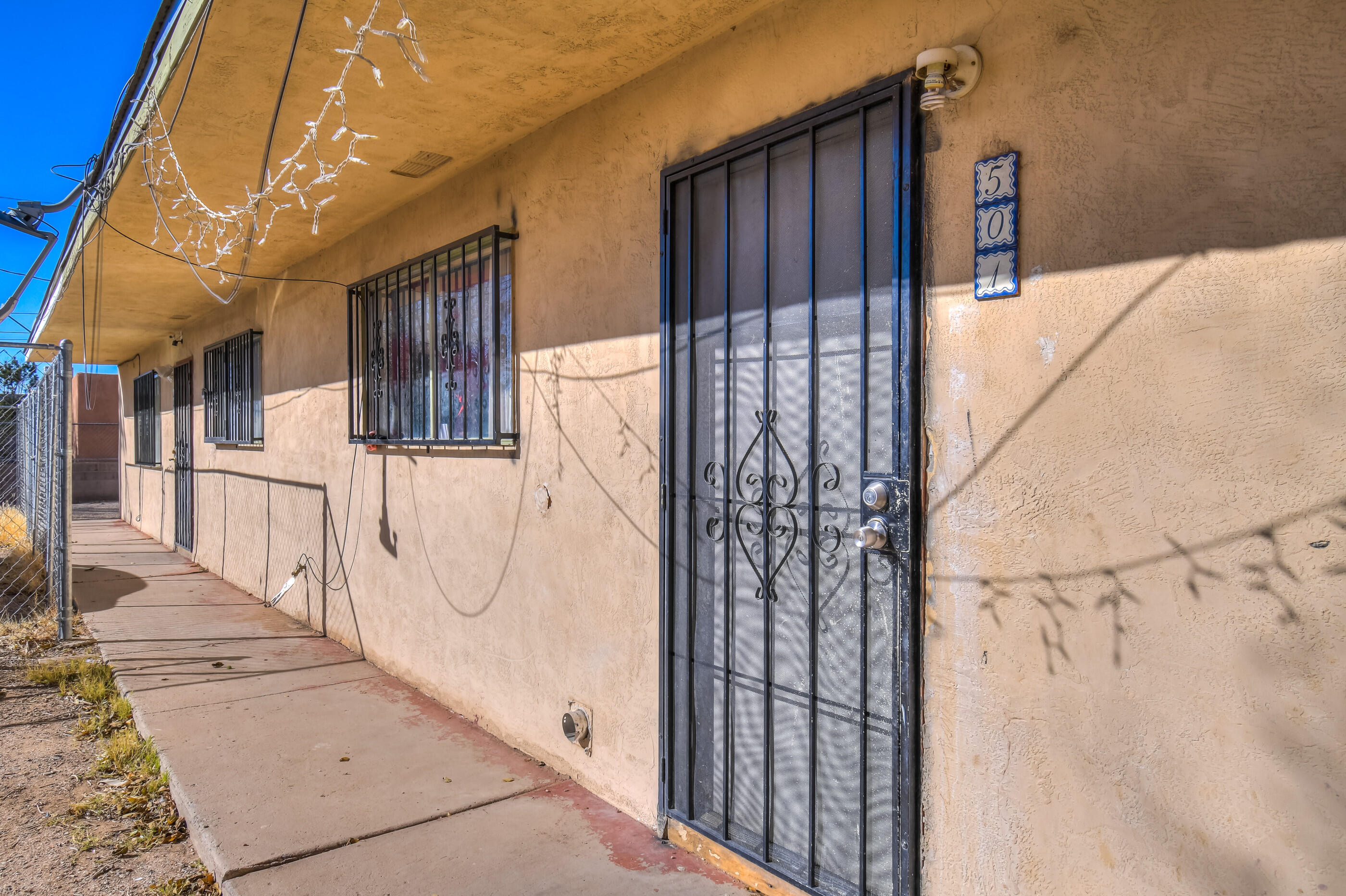 BRING ALL OFFERS for this Cozy Little Charmer!! Great Investment Opportunity or OWN for less than you can rent! 2 bedrooms and 1 full bathroom condo. NEW Cooler, Ample off-street parking! Extra Storage, Private Fenced Back Yard. 501 IS THE EAST UNIT ONLY. DO NOT DISTURB TENANTS. CALL for TOUR!