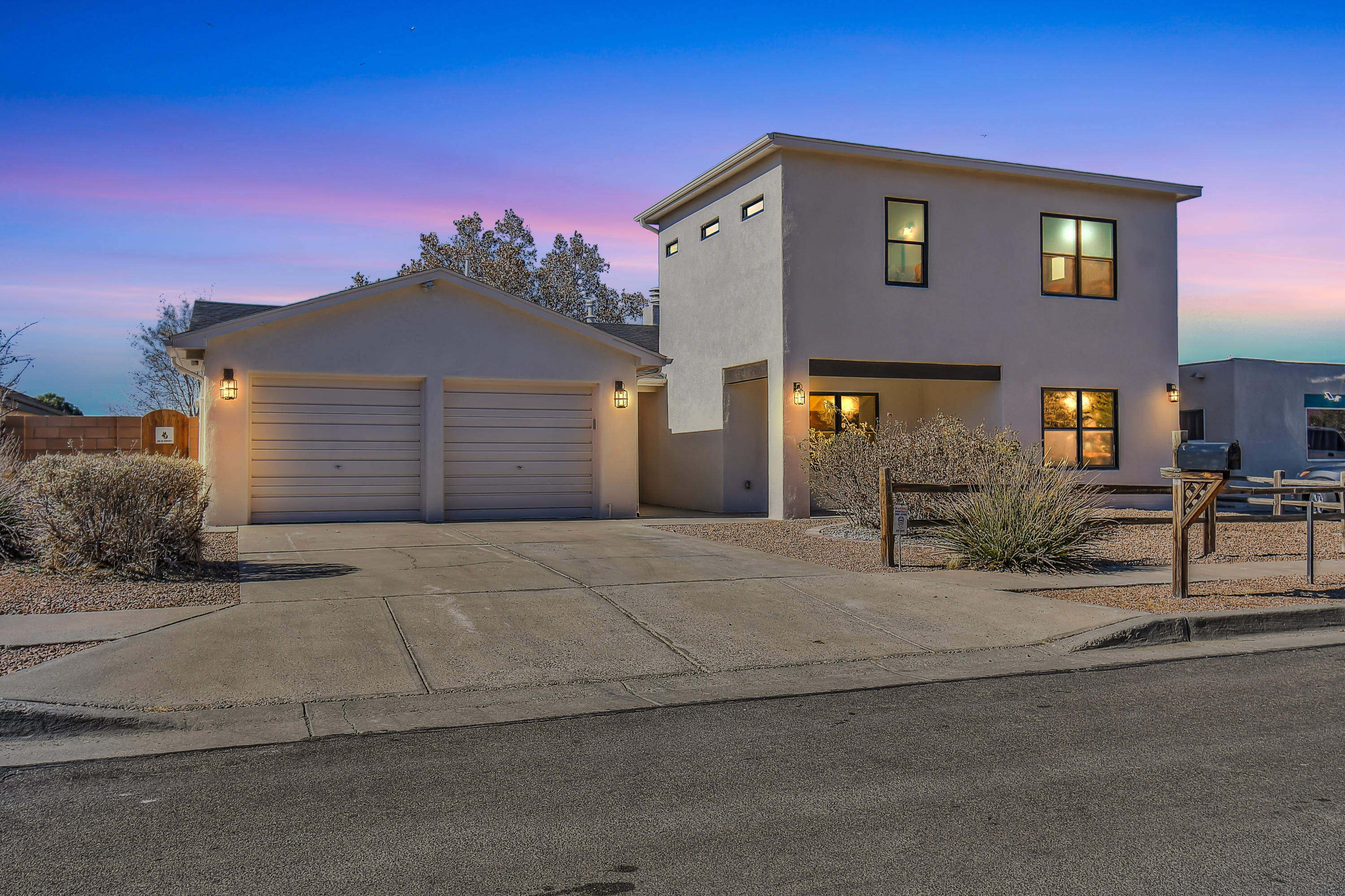 Welcome Home to Granada Hills!! Beautifully updated with 5 bedrooms & 4 Bathrooms. This home is perfect for the multi-generational living situation with 3 Main Bedrooms with Ensuites and ALL with Walk-In Closets!! Two more bedrooms with generous sqft and ample closet space. The main level of this home has two living areas, country kitchen adjoining a bright dining room, large bonus area off the kitchen would make a Huge Butler's Pantry/Prep Area or a nice Den. Also on the main level you have 4 bedrooms and 3 bathrooms and French doors that welcome you to the lawn-filled backyard! Sunshade over the patio is great for escaping the afternoon sun! The BRAND NEW luxurious Main Bedroom Suite is completely private upstairs with incredible VIEWS of the Sandia Mountains! HURRY HOME!!