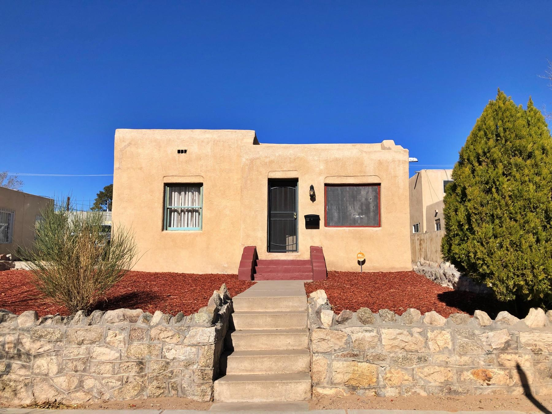 See the 3-D Virtual Tour! Sweet 2-bedroom light & bright adobe-built home in Silver Hills, an historic neighborhood sandwiched between UNM & CNM--easy walk/roll to both. Good to know: nicely updated plumbing & electric, new kitchen cabinets with 'wave-drop' backsplash, stainless appliances & great breakfast nook. Plus, updated glass tile bathroom, new light fixtures throughout, original hardwood floors & a vintage pumice-stone fireplace with tiled hearth. One bedroom wall features the exposed adobe brick. Bonus: two basement rooms totalling ~200sqft of extra storage space. Plenty of off-street parking. Also the street is zoned for the addition of accessory dwelling units (ADUs), which are being built in that section of the neighborhood, potentially adding a lot more value to the property.