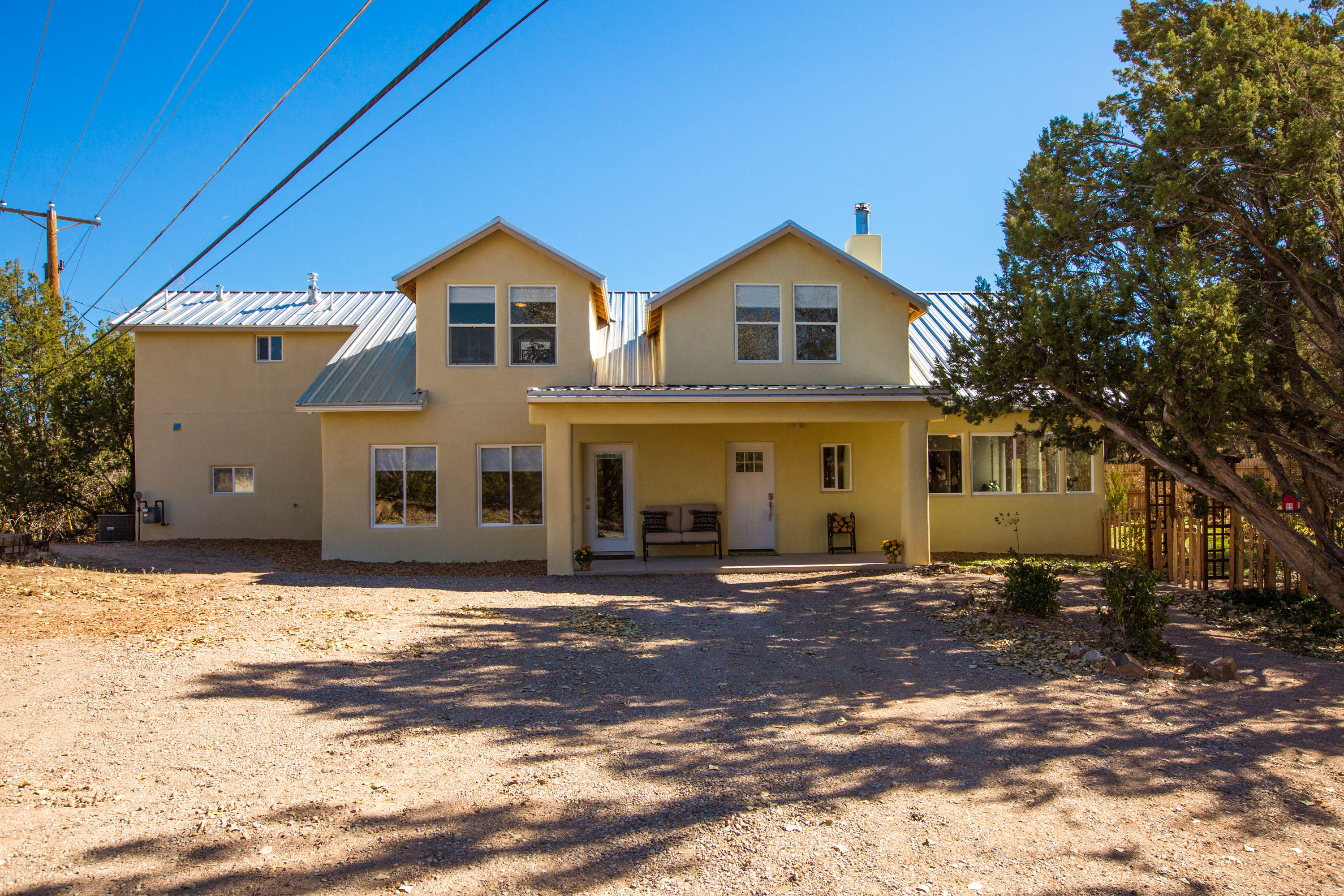 This Northern New Mexico style home was completely rebuilt and expanded, with permits and a new Certificate of Occupancy, in 2018.  Originally constructed in 1960, the remodel of this adobe and frame-built home has assimilated new style elements of today with the home's original charm. The roof to slab remodel includes: the addition of a 2nd story with pitched metal roof, 12'' ceiling supports, 2'' foam surrounding entire home, spray foam ceiling, guest bath with steam shower, RO water system, water softener, whole house water filter, hot water recirculation pump, new water heater and to 2 refrigerated air units, and 2 central forced air natural gas furnaces. Please click ''More'' for additional information on this incredible home . . .