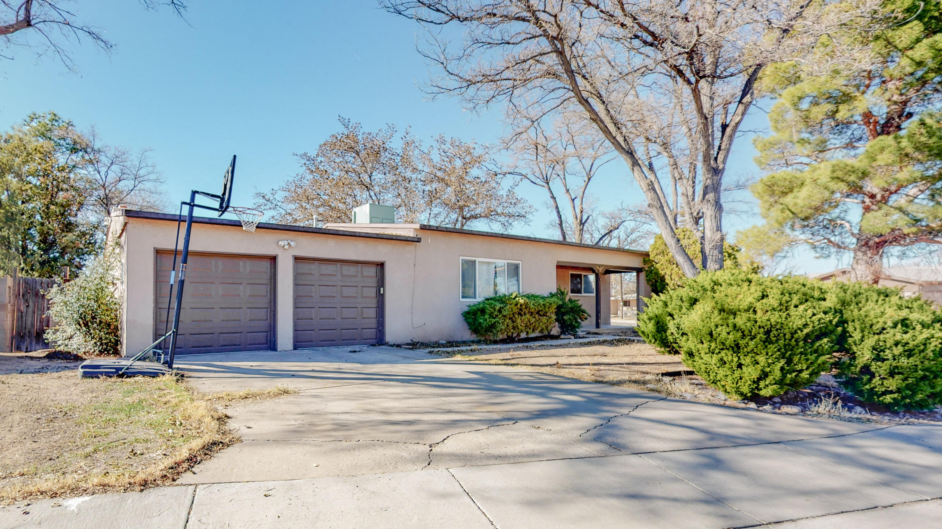 Beautifully updated home in convenient NE Uptown area near Grisham Park. Home sits on large corner lot with mature trees and features 3 bedrooms with a possible 4th bedroom/office/or 2nd living area with Kiva fireplace. Refrigerated Air Combo Unit Updated kitchen with granite counter tops and stainless appliances including full size stackable washer & dryer included! Newer windows, light fixtures and ceiling fans. Kitchen has open concept to living and separate dining area. Beautiful wood floors throughout and ceramic tiled kitchen & baths. Wood floors in main living areas refinished Nov '17! Over-sized two car garage with attic storage. Come see this amazing opportunity before it's gone and make this your new home! Easy Access to I-25 and I-40 shopping and so much more!