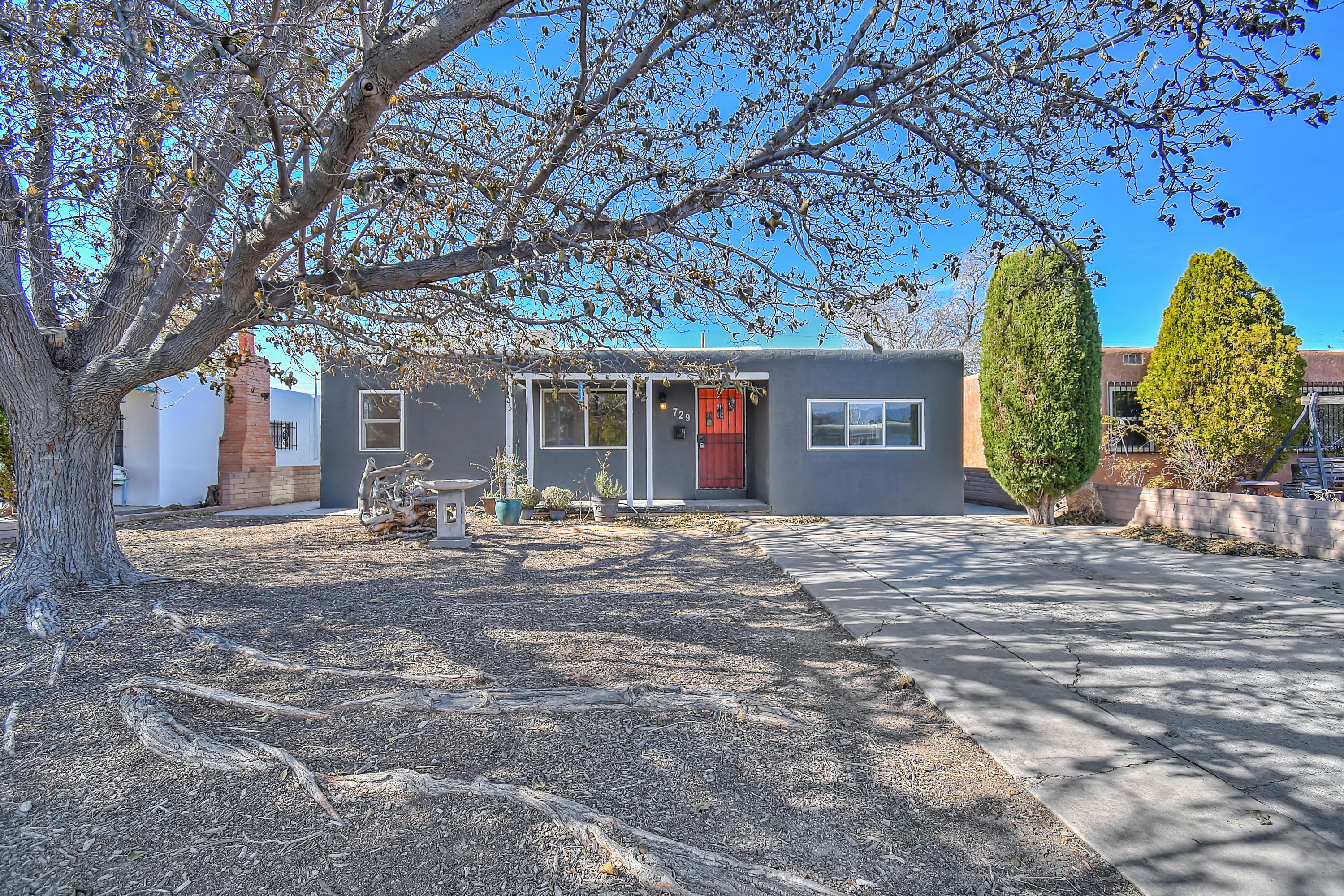 Welcome to this wonderful home just minutes to Nob Hill & UNM.  Beautiful wood flooring was just refinished and looks amazing.  Great floor plan with a large open kitchen, and the converted garage can be used as a 3rd bedroom or you could convert it back to a garage if you prefer.  Nice size dining space with newer tile, and a spacious laundry area as well.  Large backyard with a super cool workshop space, a perfect man-cave.  Newer TPO roof, windows and stucco in the last few years.  Come see this move in ready home today.