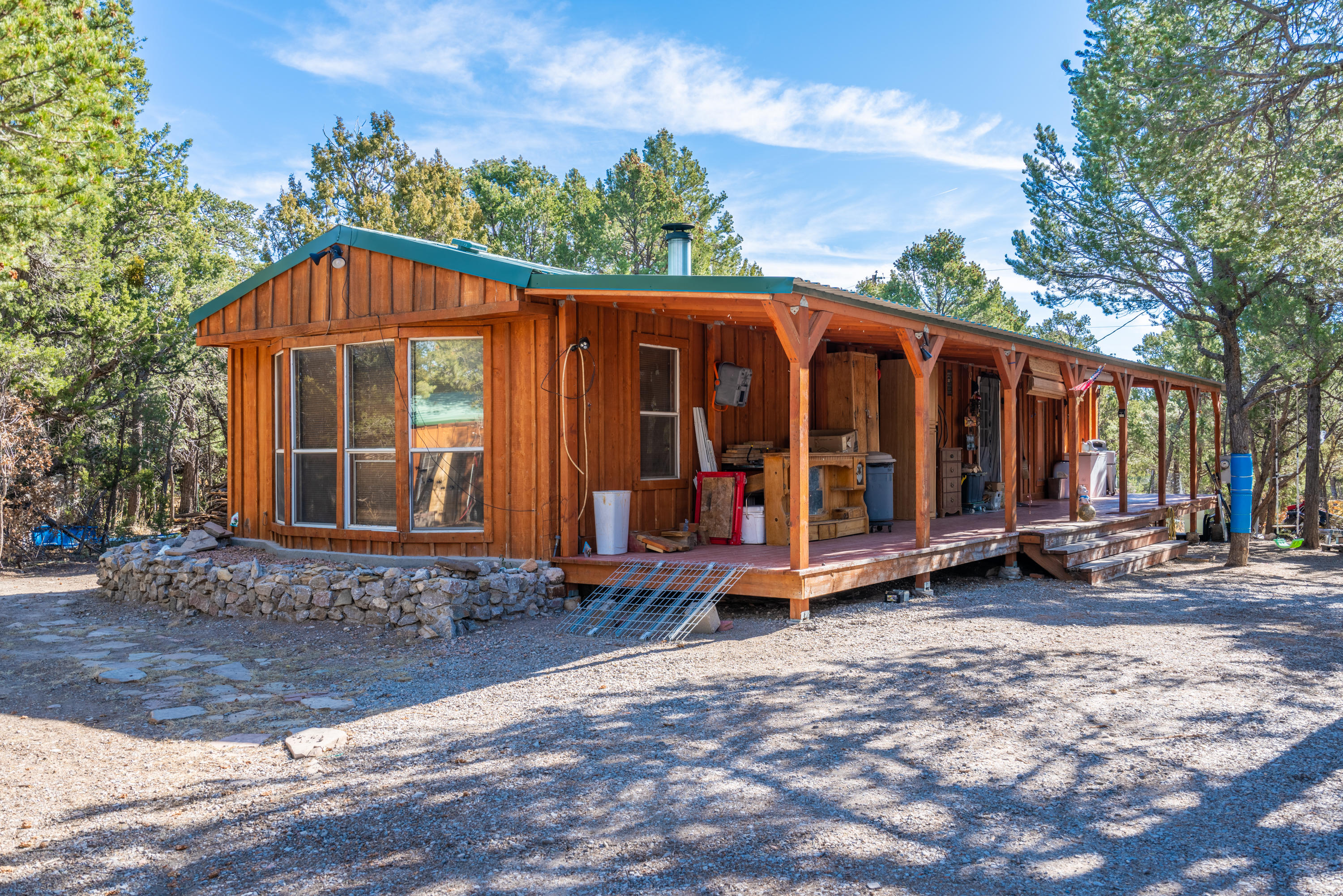 A wonderful secluded and peaceful ranch style home that's been recently updated and well taken care of. This home is located in such a great half acre space that the only noise you'll hear is the wind in the trees. The home also includes a RV pad and connections + workshop area to break down all the wood for a nice cozy fire place! Only 20 mins from ABQ, you can have the land and peace you've always wanted while being out of the city rush, but close enough to get to where you need. Schedule a private showing today! ( New floors to be added before closing)