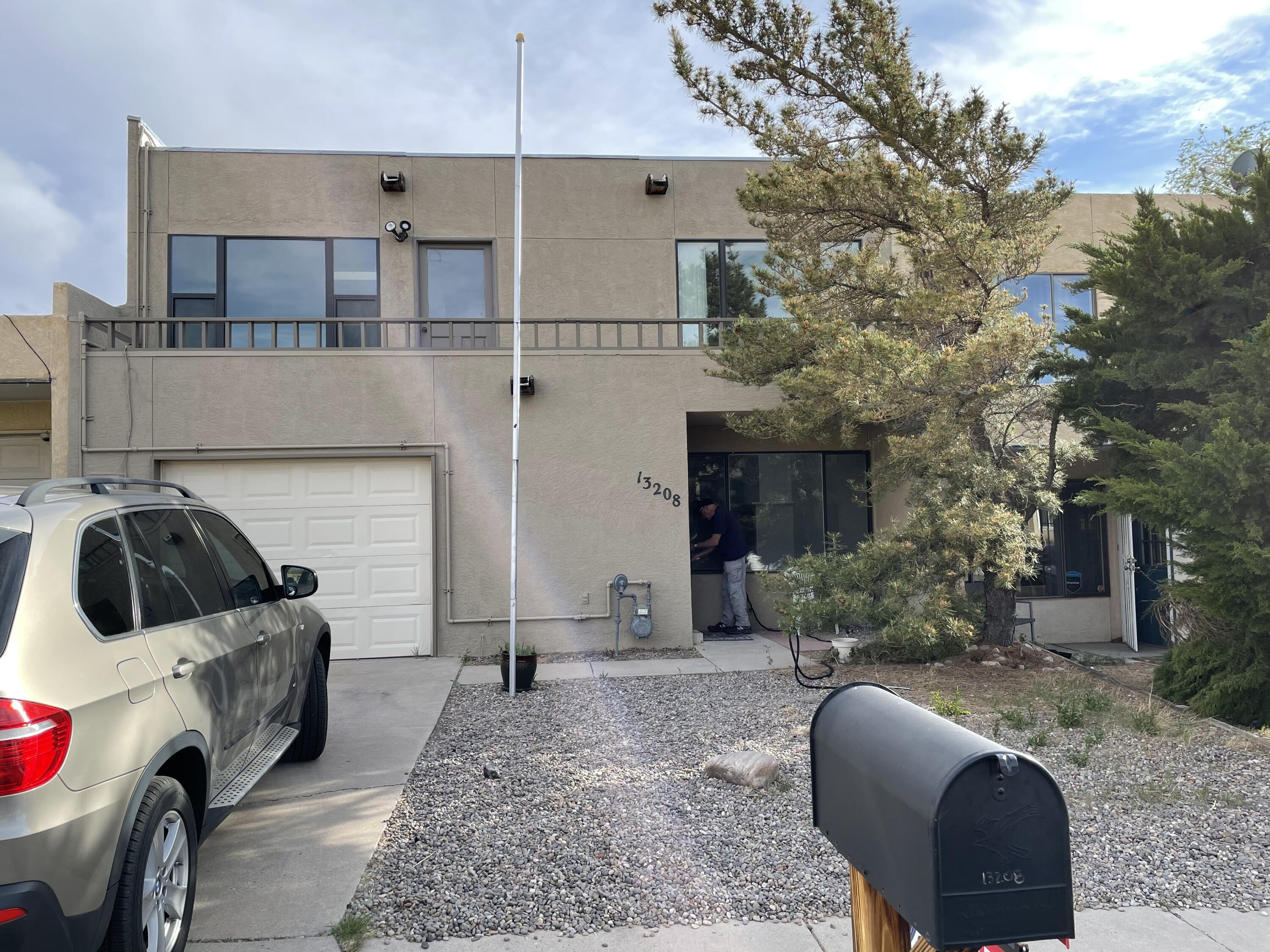 Spacious Townhouse!,  Open floor Plan with Much Light!, Cathedral Ceilings Bamboo Floors, Fire Place, Skylights, 4 Large Bedrooms with Access to a Balcony or Porch, Front Balcony with Views of the Sandia Mountains,  2 Full Bath, 1 Car Garage,  Washer and Dryer Stay, Close to Walking Trails, Parks and Shopping, Easy Access to Main Roads, Please Follow COVID Guidelines Wear a Mask and Gloves.