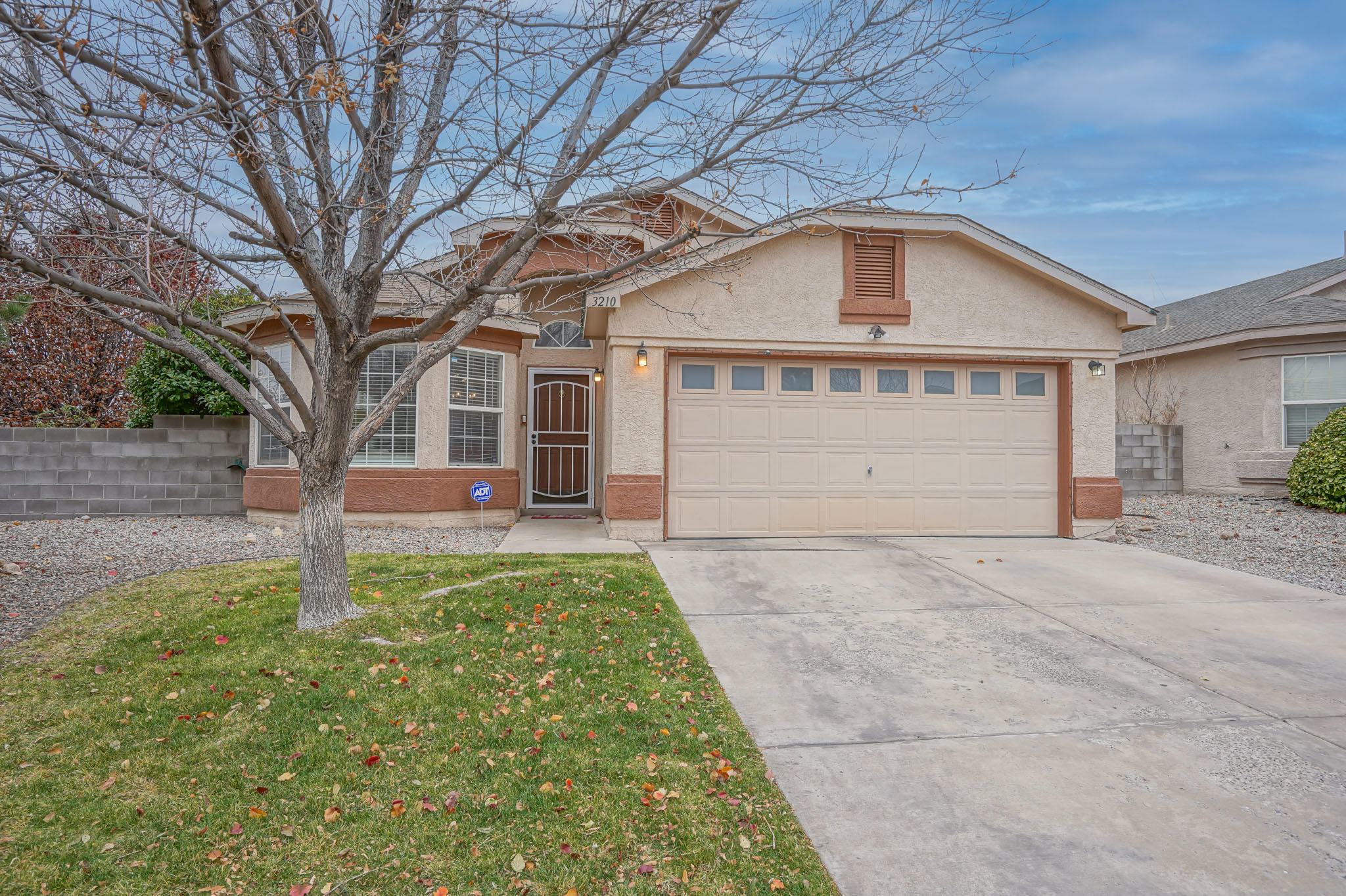 ONE YEAR OLD ROOF!!!  This 3 bedroom home with its open concept and vaulted ceilings, feels as spacious as it is beautiful.  Warm laminate wood floors greet you as you enter the formal living/dining space.  A nicely upgraded kitchen with decorative tile backsplash and an island are the highlights of the kitchen.  All kitchen stainless steel appliances convey to include built-in microwave and refrigerator.   The second living room/family room has an inviting gas fireplace with beautiful stone-front  surround.  A large backyard secured behind a fence with double-gate SIDE-YARD ACCESS and concrete pad on a fully landscaped, oversized (almost 1/4 acre) CORNER lot complete the amenities of this well thought-out home.  The HOA waters and maintains the front landscaping.