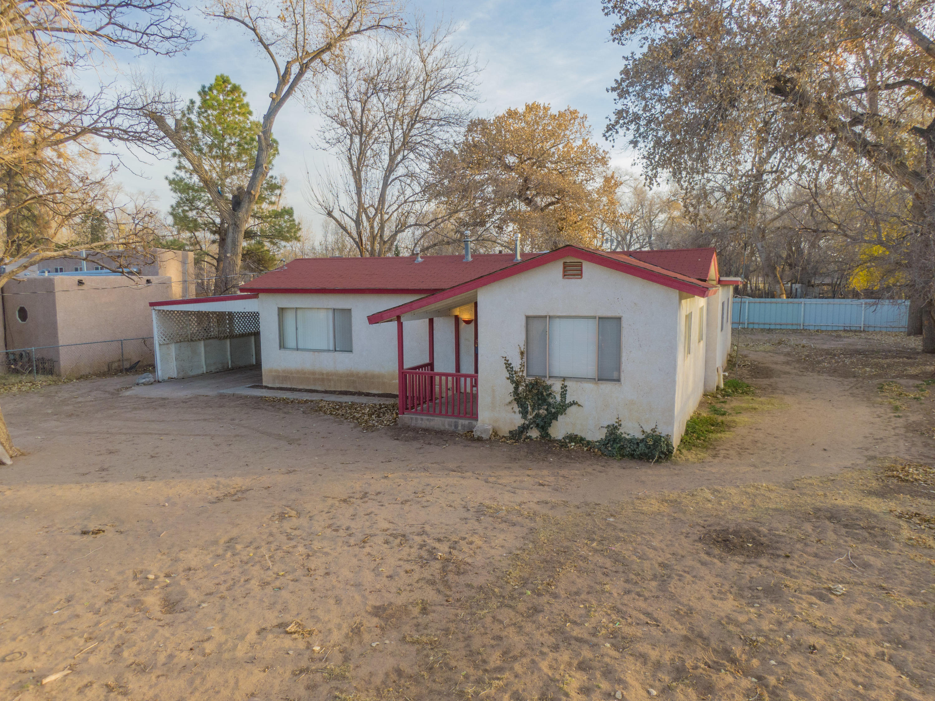 Spacious Home on .69 Acres in the Heart of the South Valley. Peaceful living under the trees. Some original wood floors, Sun Rooms...   just update to your liking. Fenced & Gated. Come visit today.