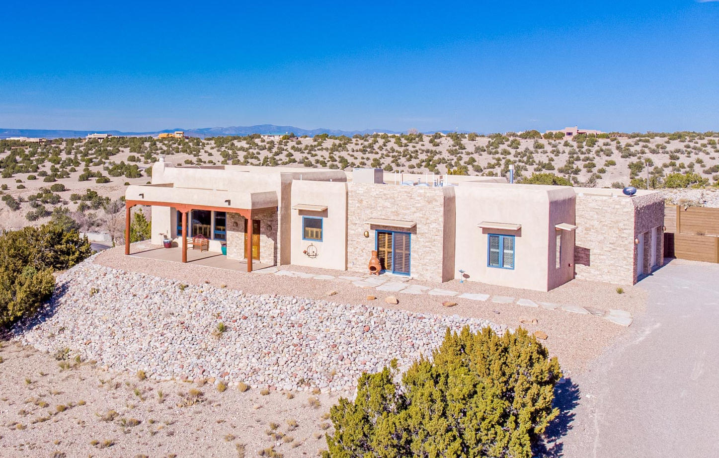 Exceptional beauty Placitas home! Panoramic views!  Gourmet kitchen of your dreams with updated appliances, beautiful custom cabinets, prep sink and double ovens. Master bedroom has his and hers vanities, jetted tub and separate Steam shower! This is the home of your dreams with views to die for!