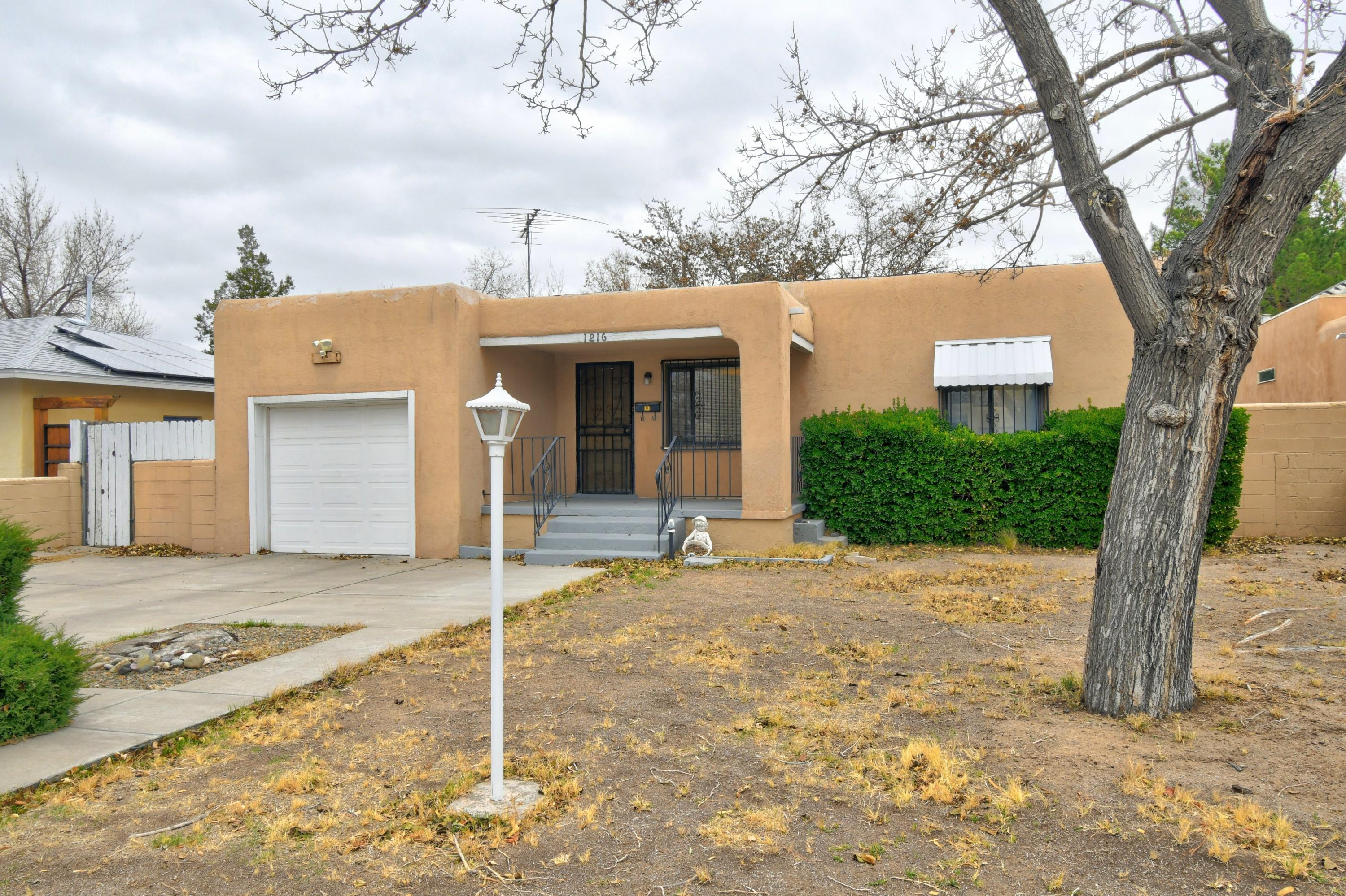 Charming home in the UNM area with a ton of character and cute curb appeal! Spacious kitchen with a ton of cabinetry and counter tops, updated and modern bathrooms, ceiling fans, cove ceilings and beautiful hardwood floors in the living room! Cozy backyard with a relaxing covered patio and an extra storage building!