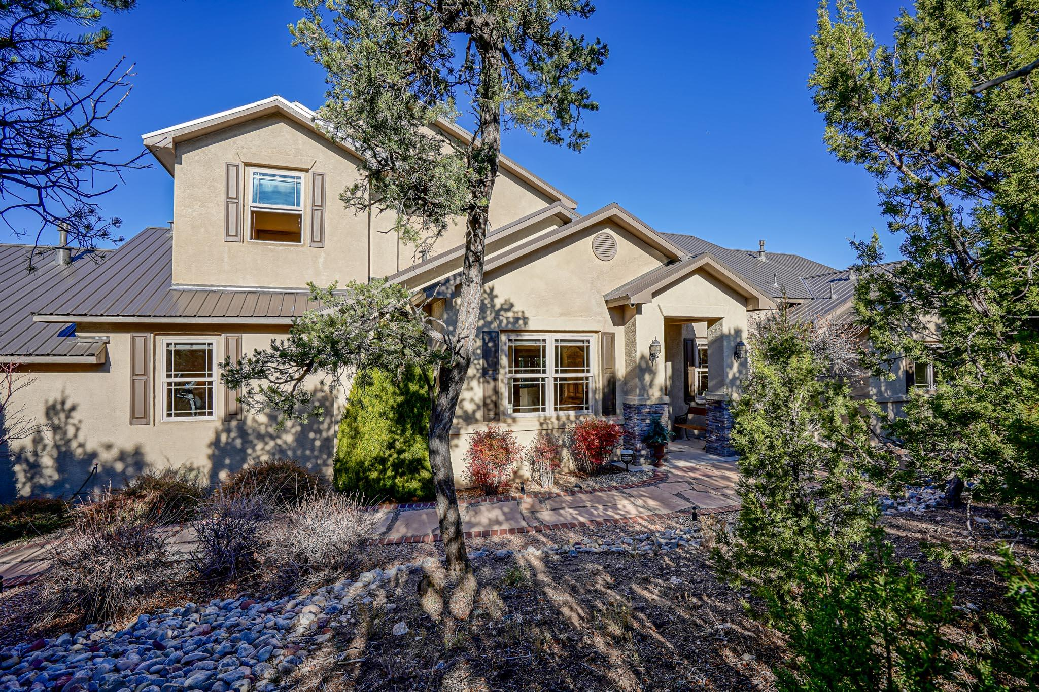 SPECTACULAR Sandia Views! Stunning & Spacious w/Ultimate privacy on 2.2 acres in desirable Tablazon Valley!  Gourmet kitchen w/island, granite tops, cherry cabinetry, SS appliances, large pantry & breakfast nook. Great room w/soaring ceilings, formal dining & stacked-stone fireplace. Entertain & unwind on the expansive covered deck w/outdoor kitchen. Downstairs master retreat boasts luxurious en-suite bath w/custom stone fountain, his & her sinks & closets, walk-in shower w/2 showerheads & soaking tub! Great floorplan w/ 2 bedrooms, full bath, loft/2nd living room & private deck upstairs.  Two additional bedrooms (one en-suite) downstairs, great for multi-generational/functional living. Pristine oversized 3-car garage & new roof. Enjoy the wildlife & nearby trails! Just minutes to ABQ!