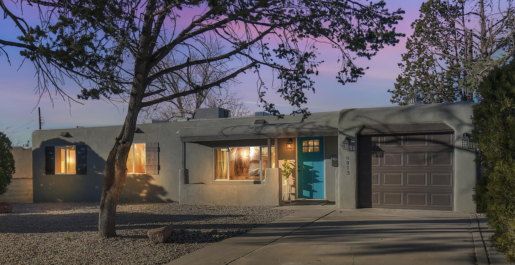 Welcome Home to this Stunningly Renovated & Remodeled Gem in Uptown Albuquerque! This 4 Bedroom, 2 and 3/4 Bath home has 2 large living areas, 2 masters, fully landscaped front & backyard, refrigerated air, & custom finishes. No expense or detail was spared on this extraordinary rehab! From the intricately laid Herringbone Tile Floors to the Hand-Made Custom Cabinets in the Kitchen w/ Soft Close Doors; Black Walnut Accents; & pull out Spice Rack, to the Second Master Suite Addition w/ Luxurious Spa en-suite. You will be amazed by the quality of craftsmanship. There was not a stone left unturned w/ the New TPO Roof, New HVAC & Duct Work, New Stucco, New Sewer & Water Lines, New Electrical Panel & Full Electrical System Overhaul, New Gas Lines & Service, New Water Heater, New Appliances, etc