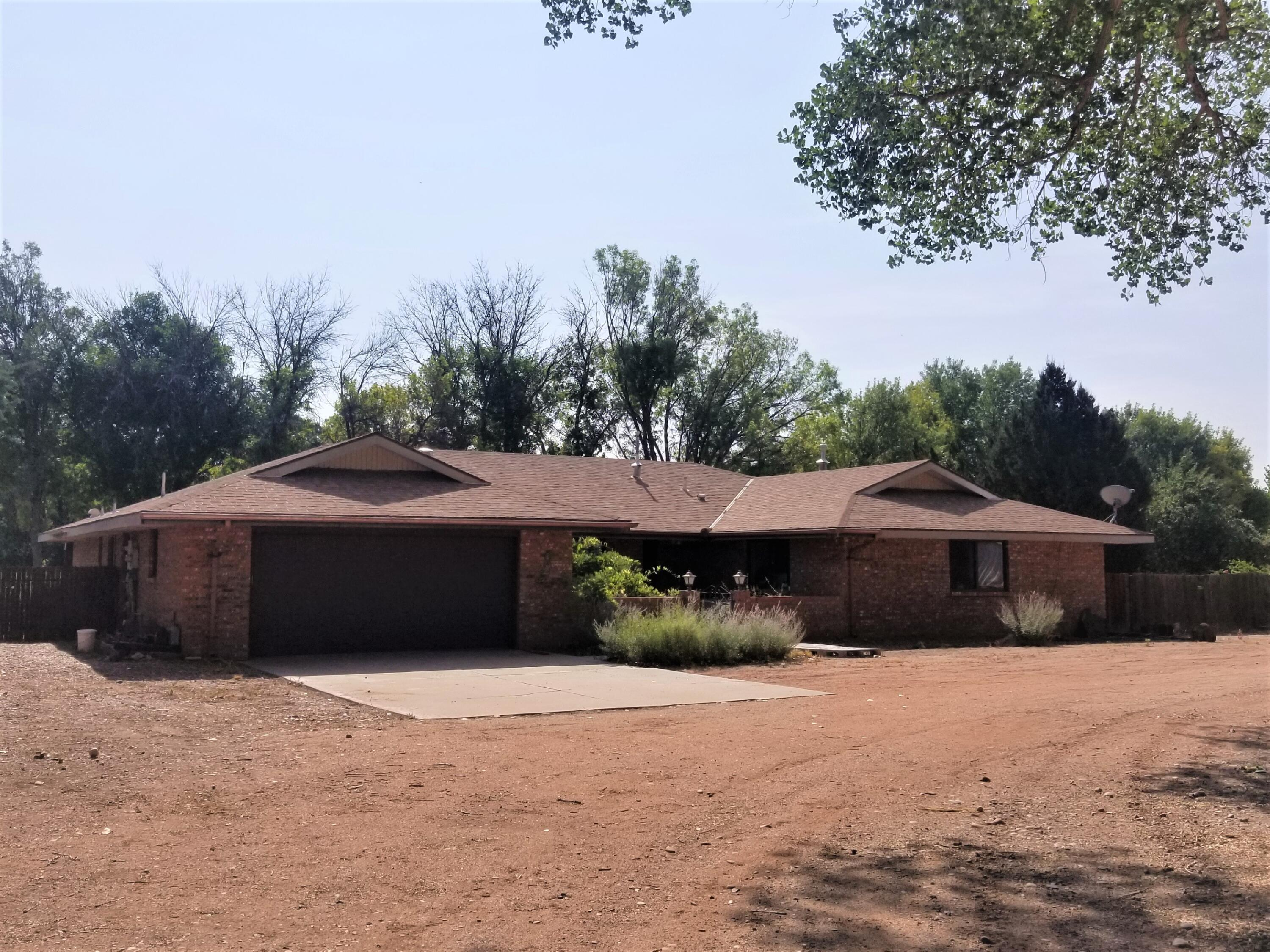 Stunning property nestled in the heart of beautiful Bosque Farms. This 2840 sf all brick home. Sits on almost 12 acres. Five out buildings. Great for horse training, breeding or any sort of equestrian operation. Highly yielding alfalfa field, or you could convert it to a commercial grow operation. The field is irrigated via a concrete ditch with MRGCD irrigation rights. Recently laser leveled and can be reseeded. There is a 40 x 60 insulated steel building that holds 9-12 cars or 3 large motorhomes. Additional 2 car garage, equipment and hay sheds. Just a short drive to Albuquerque downtown and airport. Golf, tennis, skiing, sports venues and casinos close by. Short drive to mountains for camping, hiking and fishing. Come see the possibilities this beautiful secluded property has to offer.