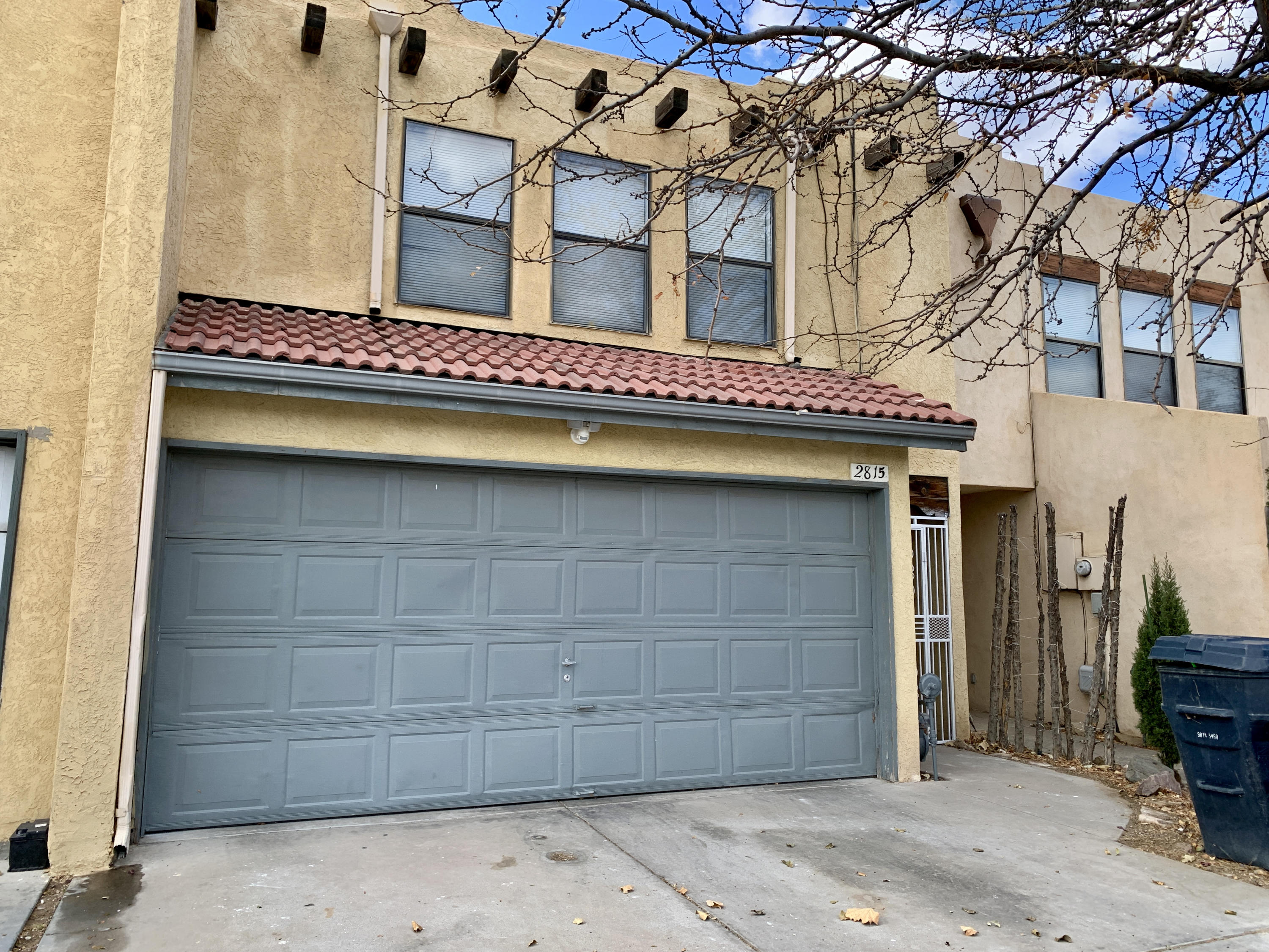This beautiful, well maintained Townhome has 3 bedrooms, 2 1/2 bathrooms and a two car garage. The spacious living room with a cozy wood fireplace connects to the dining and kitchen areas, creating an open and social space.  The master bedroom is large, with three closets and a private full bathroom.  An enclosed back yard is ready for your personal landscaping touches. The newly installed TPO roof has a warranty that transfers to new owner. No HOA