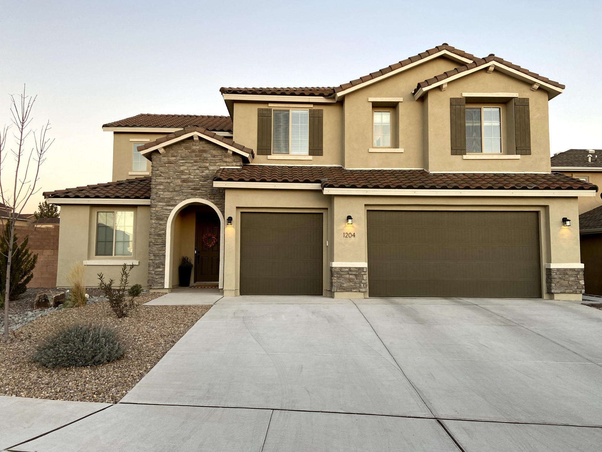 Finally enjoy social distancing in this luxurious, 2018 home on a large corner lot. Located in a pristine neighborhood, this home features many upgrades and luxury touches including three car garage, granite countertops, tankless water heater with recirculation pump, full professional landscaping, epoxy garage floor, built-in surround sound systems, smart home features. 6 bedrooms, with master on first level and guest suite with private bathroom. Backyard features drip irrigation, basketball court, and 2020 Hot Springs Limelight Spa.