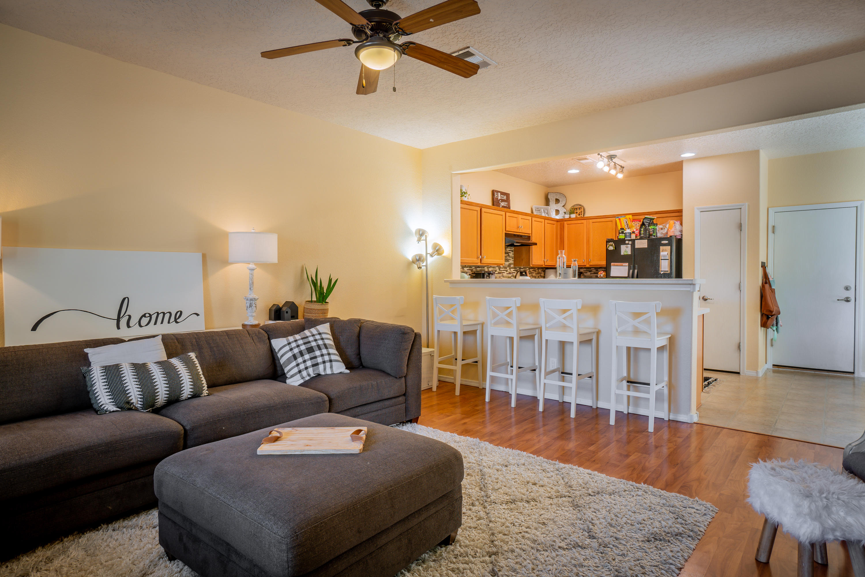 Gorgeous townhouse located in the highly sought after Presidio gated community!  This townhouse is located just minutes from ABQ Uptown and prime shopping centers.  Quick I-40 access, minutes from the Sandia foothills and national labs.  The property features a beautiful 2 bed, 2 bath, 2 car attached garage floor plan surrounded by gorgeous landscape.  Tankless hot water heater, refrigerated air and tasteful updates. Contact your favorite realtor for a showing!