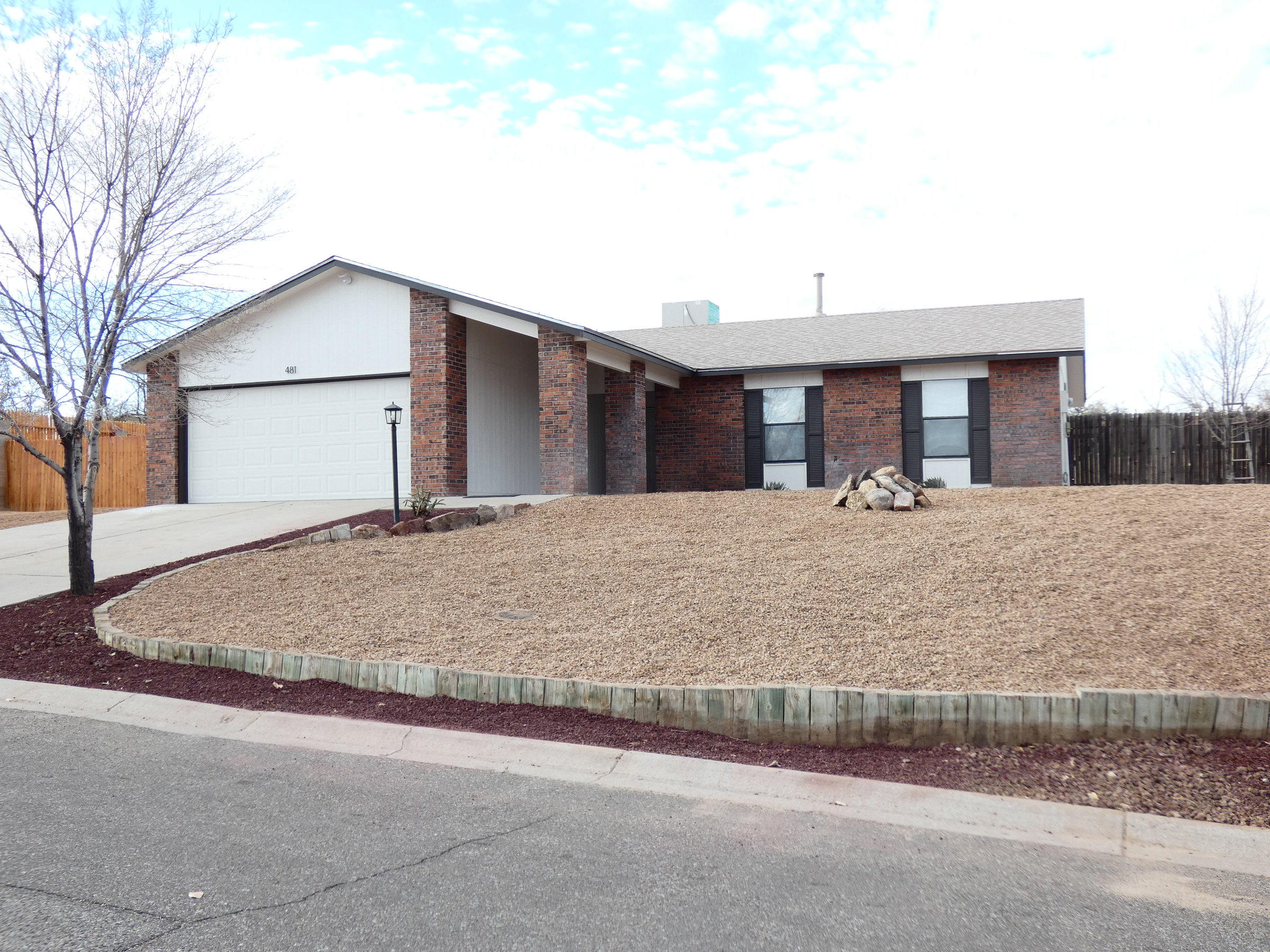 Amazing Transformation!  4 bedrooms, 2 bathrooms on .37 acres.  New roof, new skylights, new furnace, new water heater, all new countertops with undermount sinks, new range, new dishwasher, new tile backsplash in kitchen, custom tile surrounds in hall bath, custom shower in master bath, new lighting, all new flooring, updated fireplace with mantle, new plumbing fixtures, new blinds, three walk-in closets, corner lot, new front landscaping, new paint inside and out, frig, washer and dryer. Have an RV or lots of toys?  No problem here.  And just a short walk to beautiful Vista Hills Park.
