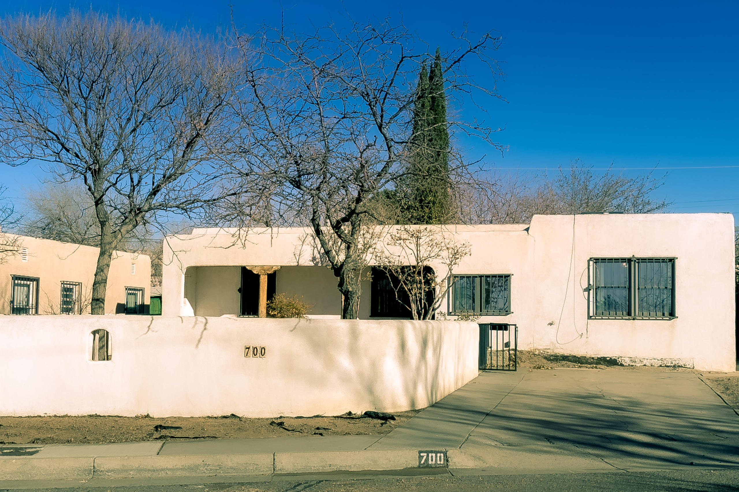 Charming S UNM Victory Hills pueblo-style casa w/ tons of upside potential! Nestled on a quiet block, the 3 bed, 1.75 bath residence offers approx 2,052 square feet of versatile space. Costly recent upgrades include updated elec panel/service & CFA heating/refrigerated AC combo (both 2019). Living room front side & generously proportioned family room at the back w/ electric heated fireplace & French doors to the back patio. Large kitchen w/ adjoining flex-space (possible 4th bedroom/office/3rd living space) & separate dining room. Outside: private walled front yard, covered front porch, sizable covered back patio w/ yard space to spare. Conveniently close to UNM & in the highly desirable Bandelier ES district. Listed ''as-is'' and priced accordingly- an excellent investment opportunity.