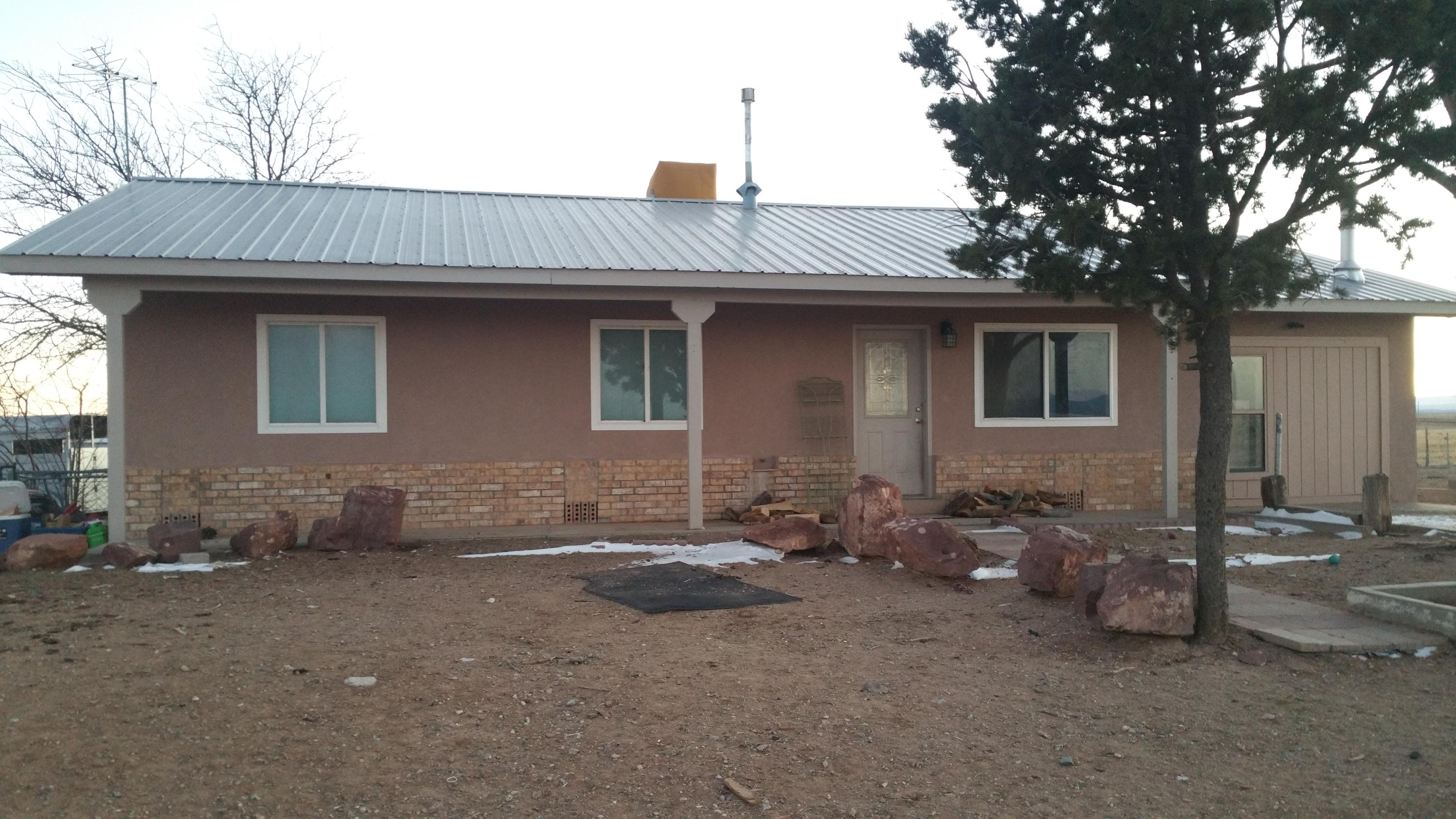 Bring your horses, pets, & enjoy the fully fenced unrestricted property.  Short drive to Albuquerque, Sandia Mountain, Sandia Labs, Kirkland AFB & newer horse arena in Stanley, NM.  Enjoy the beautiful sunsets & views!  Covered patio could be your new outdoor kitchen or fire pit retreat. Metal 30' X 30' Horse Barn, 2 roll up doors, side walk in door & 2 stalls. Fully fenced 5' non-climb horse fence on unrestricted  approx 1.5 acres.  2018 new deep well, Jotul wood stove, & water heater.  2019 stucco. exterior paint, well house roof & exterior.  2020 new wall oven, recent paint, new den floor, upgrade to covered patio interior & exterior.  many nice upgrades made each year. Move in ready. Welcome Home!