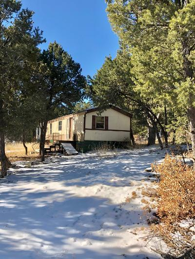Want a Weekend Get Away?  This Beautiful 5 Acres has Gorgeous Views with all kinds of Pines, Alligator, Pinon, Cedar and Ponderosa.  It has a well, septic, electric hook up, phone, and an older single wide MF Home that is not livable. We have no info on the home itself and being sold as land value, no title on the home. 20 minutes to Edgewood and 45 minutes to Albuquerque.  Just off the pavement of Hwy 344, cash only.  Owner will not pay for any inspections.