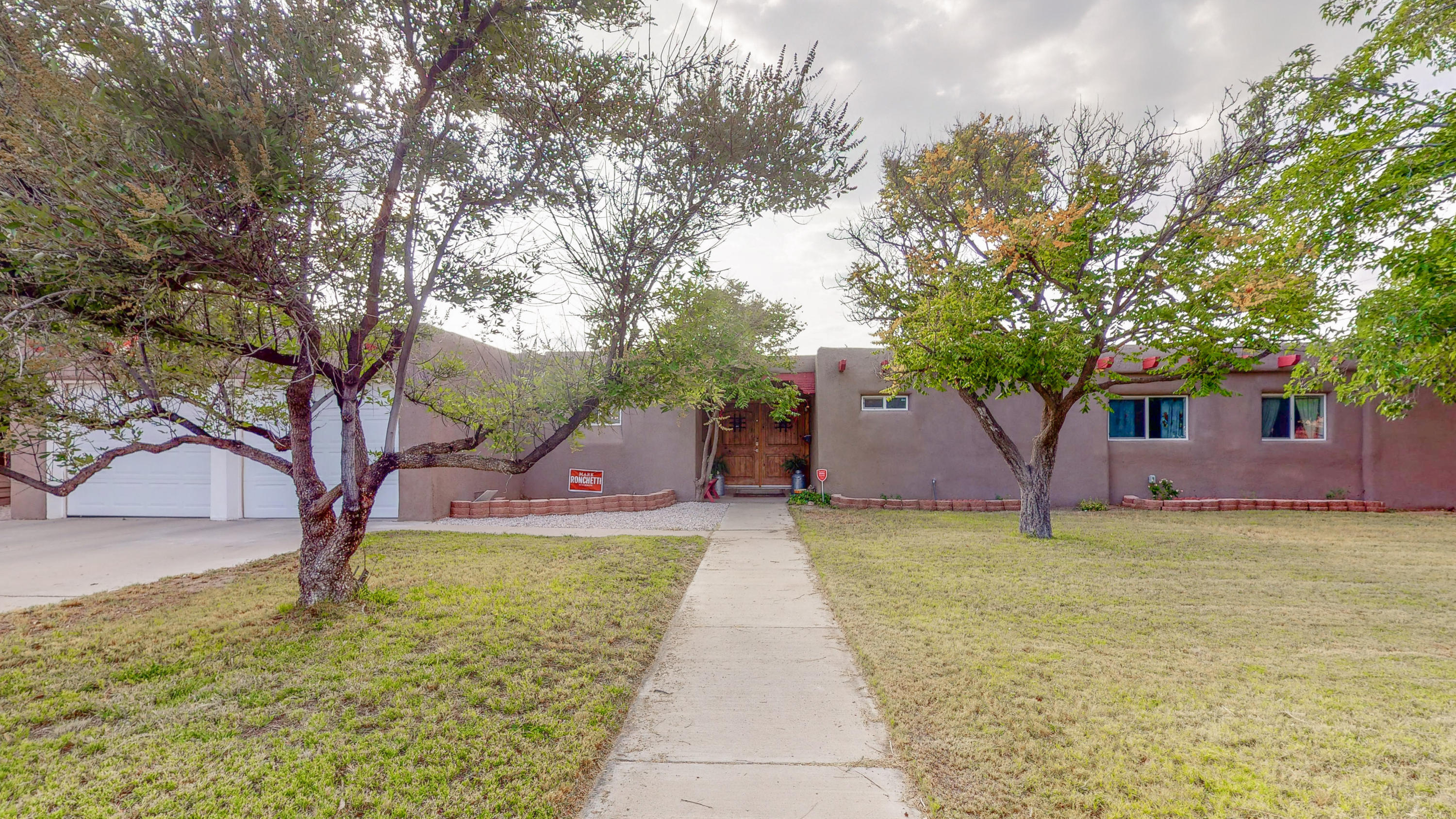 WELCOME HOME to this spacious 4-bedroom, 2-bath home in the established Siesta Hills neighborhood. Recently remodeled and plenty of new updates have been done throughout this home inside and out! This spacious homeincludes a large family room with hard wood flooring. A cozy wood burning fireplace and a separate dining area. the remodeled kitchen includes a gas stove/oven & microwave along with a separate breakfast nook.  Separate and spacious laundry room with plenty of pantry space. Large 2-car garage and a back covered patio and RV parking/backyard space. Close proximity to KAFB,restaurants & shopping. Make this lovely home yours. Schedule a showing today!