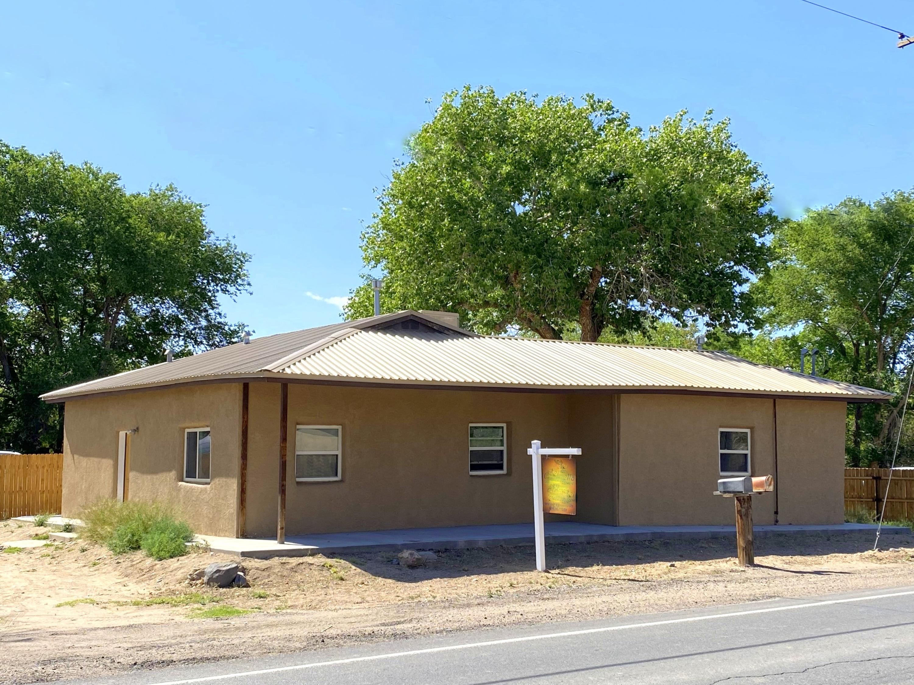 Excellent Investment Opportunity, TWO Houses for the price of one!  Located in the Beautiful Rio Grande Valley on 0.6 Acres. The main home has 3 Beds, 1 Bath, 1,140 SF frame home built in 1995.  The guest house is a 2 Bed, 1 Bath, 1,103 SF Adobe built in 1930. The walls are 18'' thick!  Wonderful for maintaining a comfortable home.  Newer metal roof on both houses in 2018.  Newer vinyl, double paned windows.  Both properties share a septic system and a shared well, installed and permitted 9/2020. Large Fenced Lot Adorned with several Mature Cottonwood Trees.