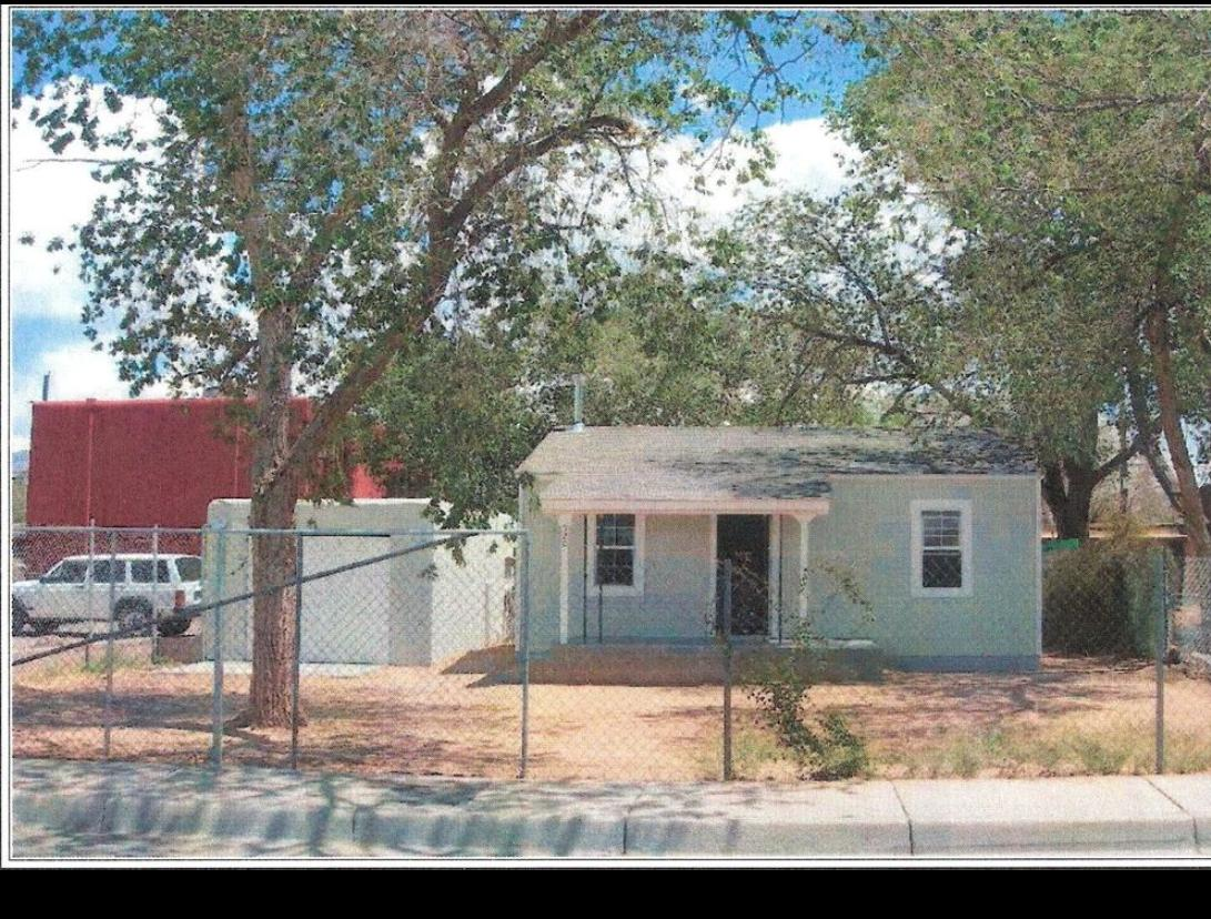 This sweet little house would make a great investment opportunity. Some upgrades to the home include newer kitchen cabinets, countertops and backsplash, newer finishes in the bathroom. Huge lot. Fully fenced. Separate 1 car garage is great storage. This sweet little home needs some TLC.