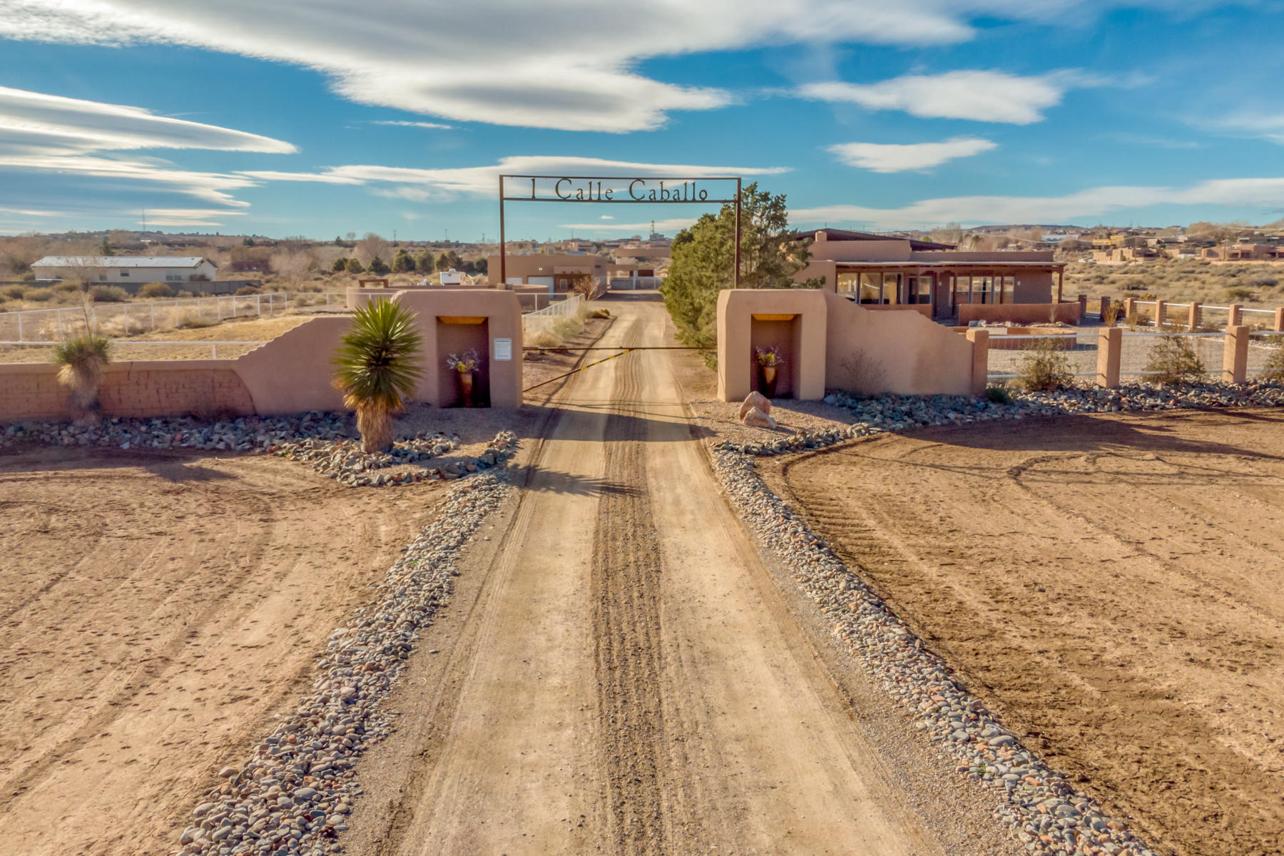 Welcome to this one of a kind, 7 acre property in historic Corrales, NM. Outdoor pens, foaling barn/shop, heated/cooled 11-stall show barn w/studio and office, covered arena, round pen, 4 loafing sheds and 3.5 acres irrigated pasture w/MRGCD are a horseman's dream. Looking for investment property? Detached Casita and separate studio are currently being rented out, creating recurring monthly income. This property has also been used by local movie industry and has brought forth a generous amount of revenue! Looking to entertain? Ample room both inside and out of the ''Big House'' offers over 2,700 sf along with incredible views of Sandias. Tile floor, vigas and high ceilings accent this home throughout. Too many details to mention and so much to see! Come check out this oasis for yourself.