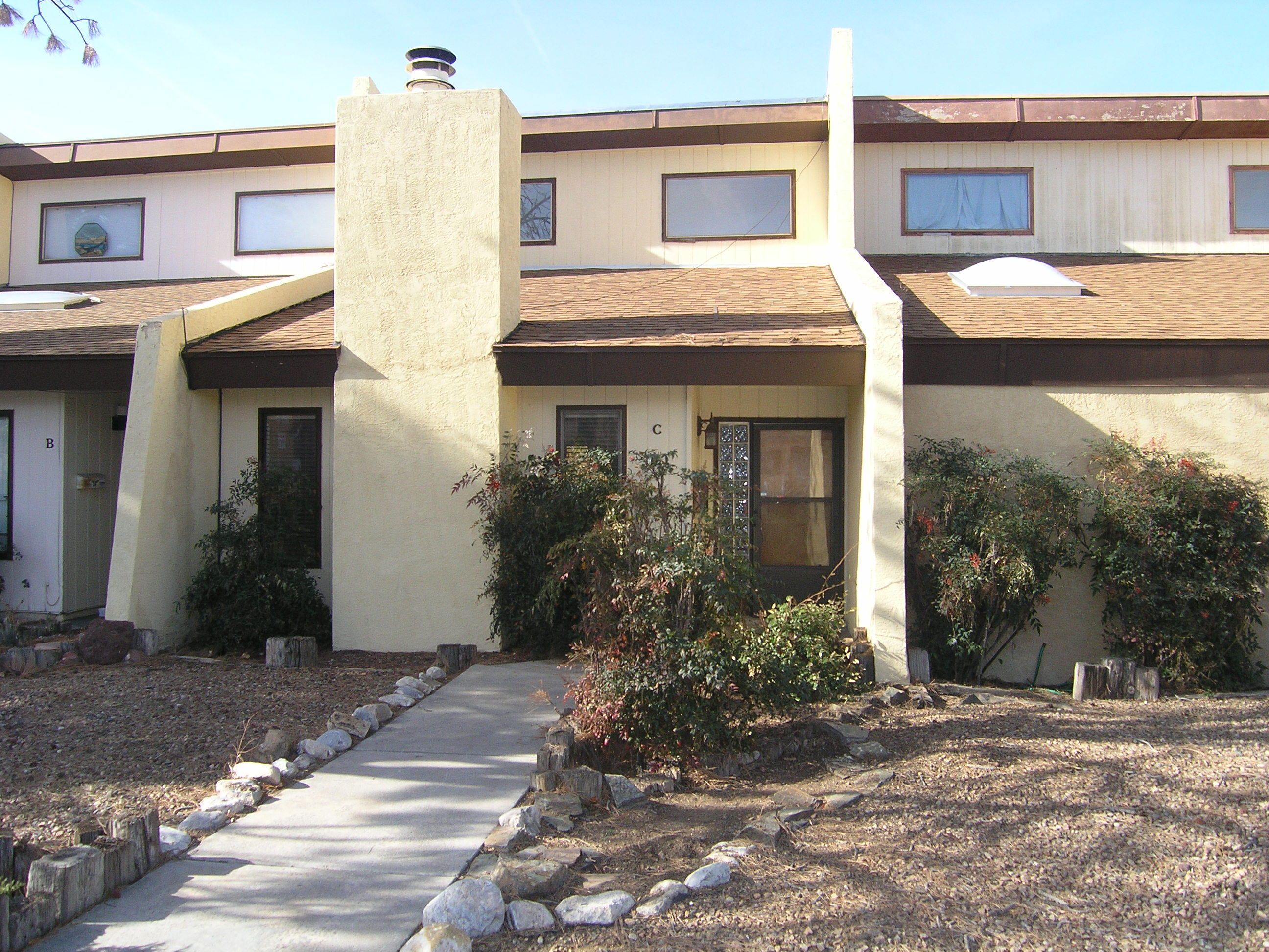 This home is the best value in all of UNM. It features a newly installed TPO and shingle roof systems (November 2020), new paint, and refrigerated air. The interior is open, light and spacious with soaring ceilings in the living room and wood burning fireplace with vintage rock surround. The dining room is large and looks onto a protected and secluded courtyard that is an ideal space for a serene rock garden.  Each floor has it's own bedroom for privacy-- ideal for a roomate or VRBO. The downstairs bedroom has a view into the courtyard.  The home features a two car garage. The house is within easy walking distance to the ART Bus lines or an easy bike ride to UNM.  Enjoy the access to the shops and dining of Nob Hill. There are no HOA fees for the unit.