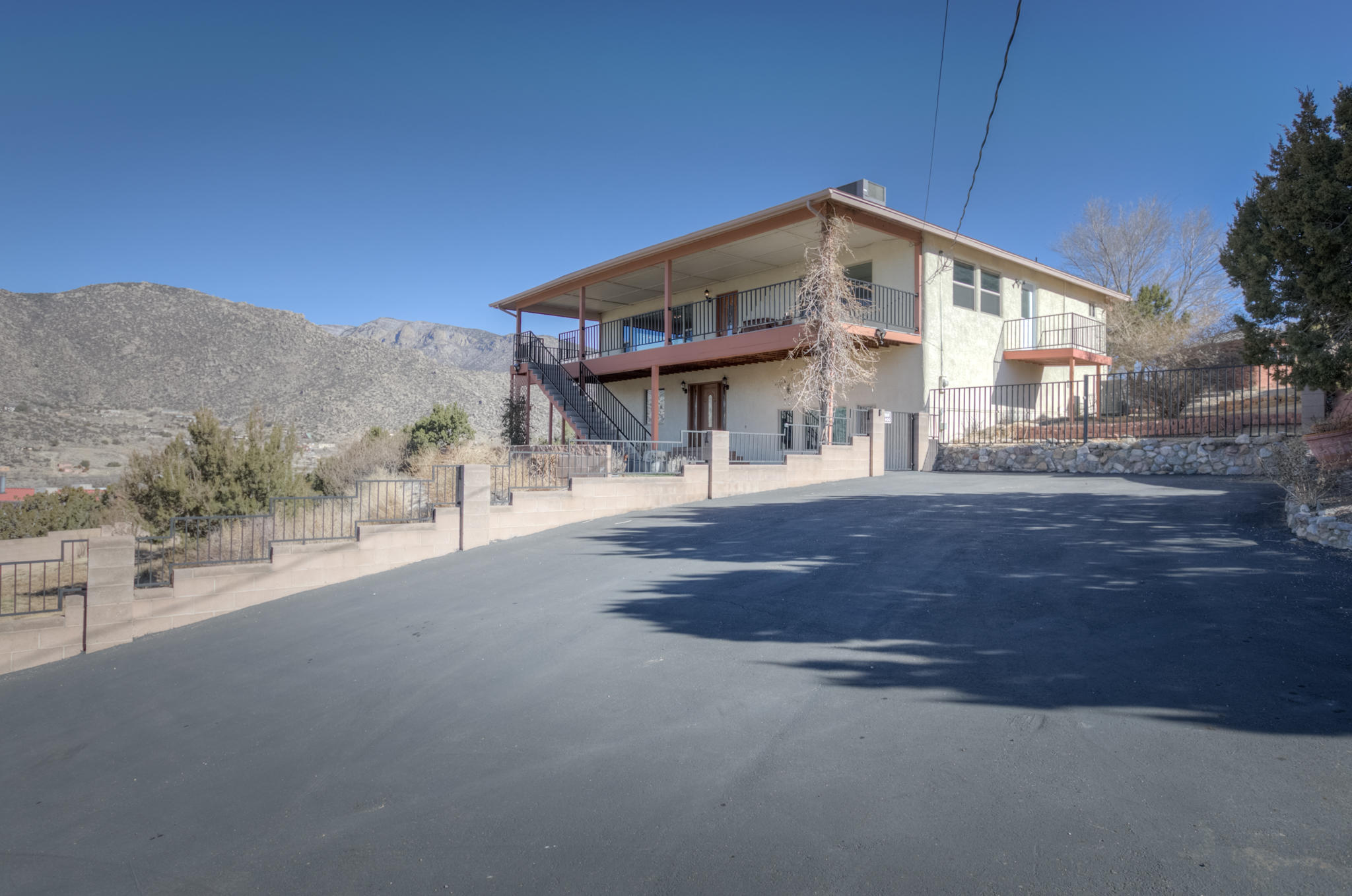 Welcome home to your own private retreat/Horse property at the base of the canyon!  2 acres of land with horse stalls and panoramic 360 degree views! Situated at the top of the hill, this home has so much to offer.  Many many updates over the years make this home meticulously maintained and ready for a new owner.  This home has a reverse layout so that the main living space is upstairs with large floor to ceiling windows to take advantage of the views.  Cozy up in the living room with a pellet stove and relax! The kitchen has granite counters and plenty of storage. Downstairs has a game room complete with an old pool table from Fox's in the 1970's that will convey! There is an additional living area, bedroom, full bath