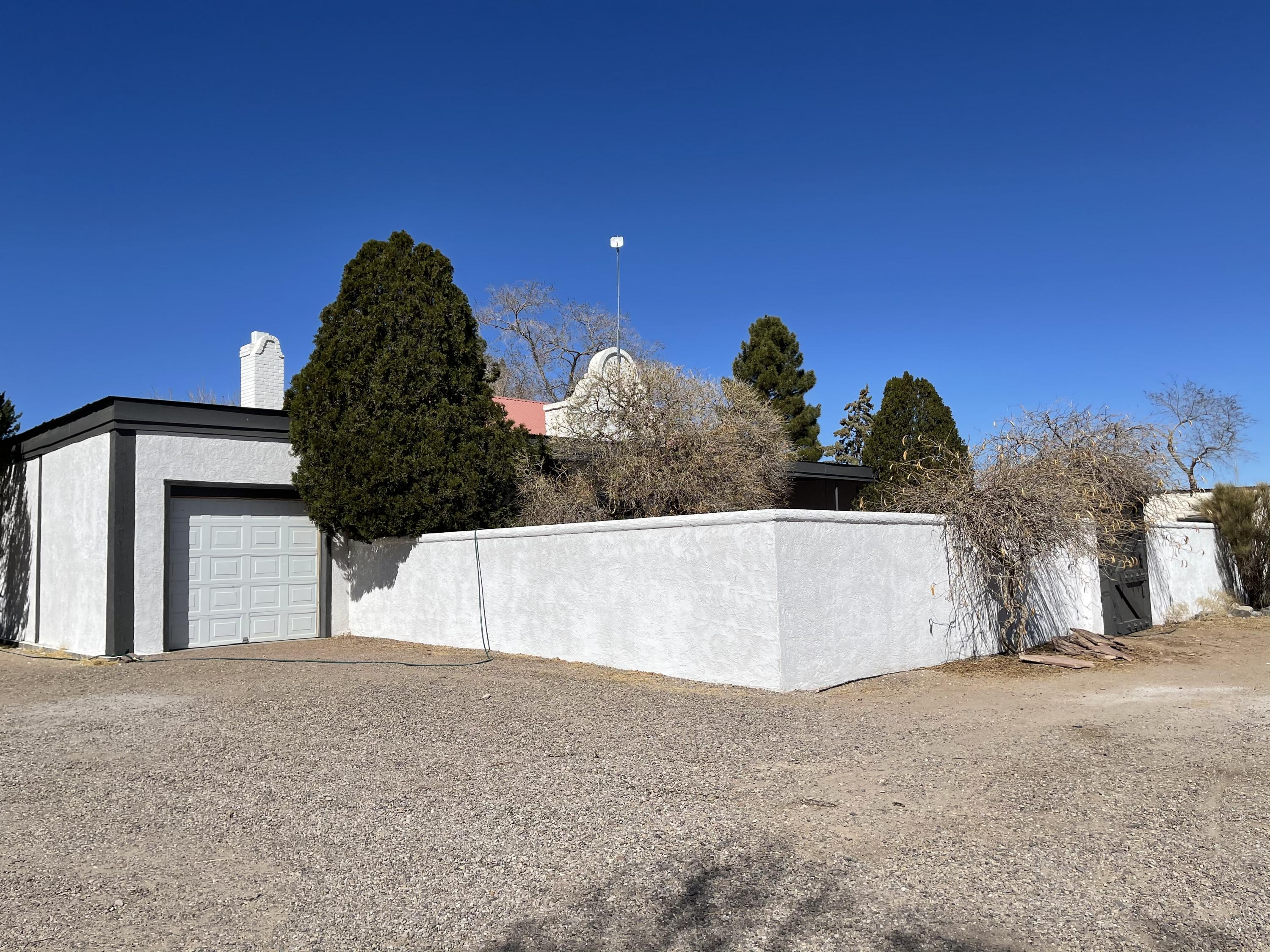 Home at last! Come & own a piece of New Mexico history. This updated, well maintained home was once a school house for Luis Lopez. It was remolded in 2020 to accommodate  for a single residence.  3 bedroom, 2 baths, dining area. Carpet, tile & laminate flooring.  Built in book cases. Loft & kiva fireplace  in bedroom. 14 foot ceilings, 10 foot doors & see through fire place. Wood pellet stove for efficient heating.  Large, walled courtyard with a covered porch. Attached one car garage with plenty of storage.  1279 SF. guest house has been remolded. Open floor plan. 2 bedroom, 1 bath & utility room.  Metal garage/shop with RV storage. Enclosed carport & a set of pins for animals. Just an hour from Albuquerque & an hour from Elephant Butte Lake.  Close to Bosque Del Apache wildlife refuge.