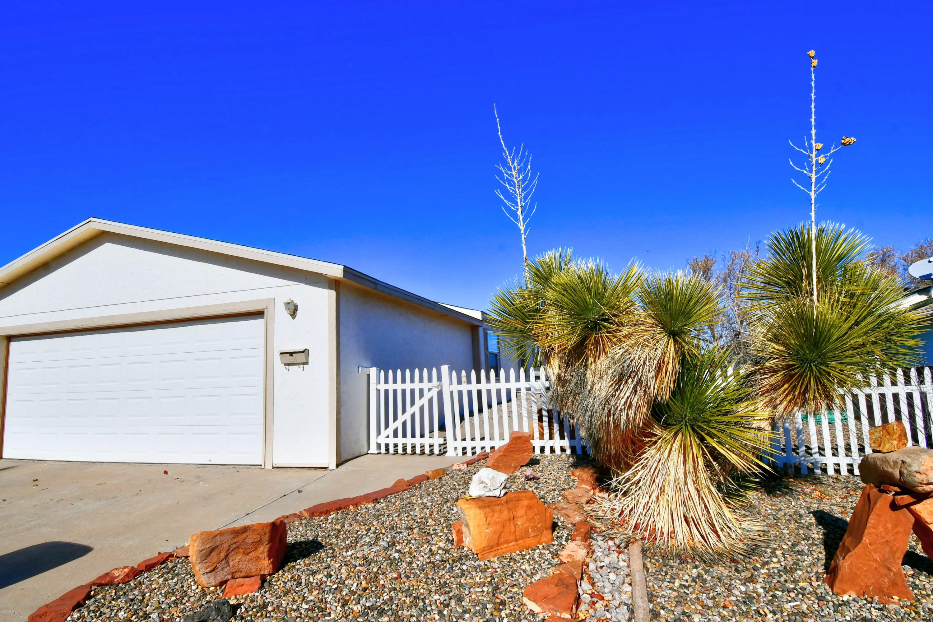 Come see this beautifully maintained home in the 55+ Community of Sunrise Bluffs! This 1904 SF home boasts 2x6 walls, a  fireplace, built-in bookshelves, huge master walk in closet, full landscaping, and a large kitchen. Enjoy the clubhouse which has an indoor pool, gym and activities. You will love living in this beautiful and peaceful community located 10 minutes south of Los Lunas and 30 minutes south of ABQ!