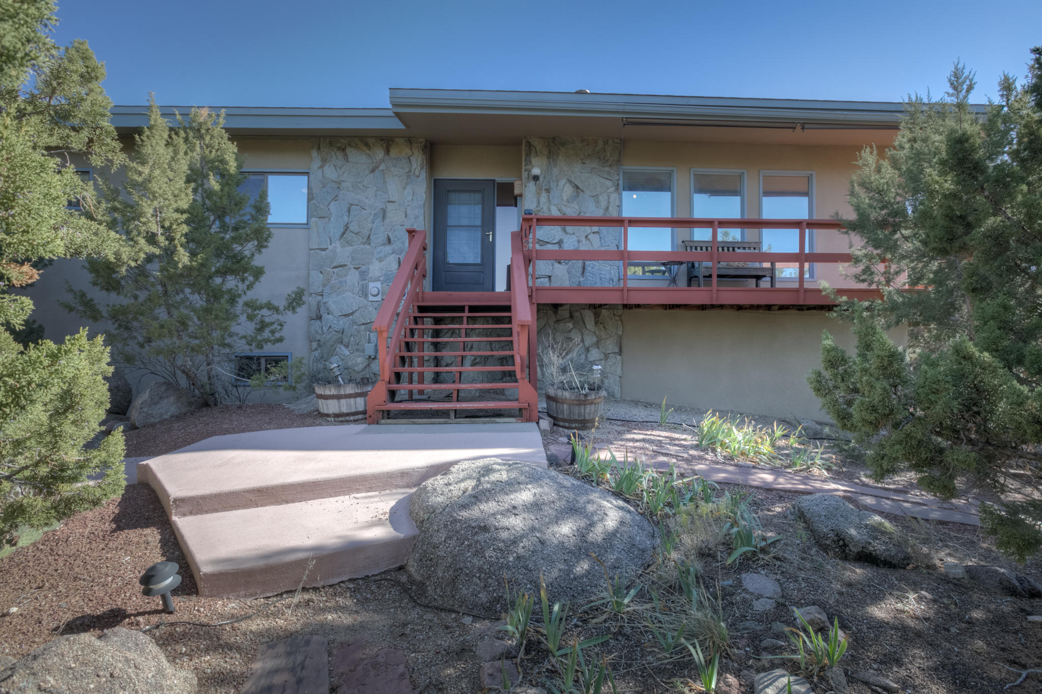 Check out this house w/ million dollar city &  mountain views on a large (.8 acre) usable lot. lots of privacy; sit on the deck or in the hot tub day or night & enjoy city and mountain views and watch the tram go up. There is a large wrap around deck w/ a gazebo w/ a fireplace, drip irrigation for plants & trees; refrigerate air, tankless water heater w/ endless hot water; & updated septic system. 3 car garage attached and 2 car detached garage. Very large open flexible floorpan living/dining/kitchen w/ real hardwood floors. Master bedroom has walk in closet & remodeled full master bathroom. Large game/media room with TV in basement with 3/4 bathroom and extra large room w/ closet that can be used as office or 4th BR. New roof in 2018 with 3 years left on transferable warrantee.