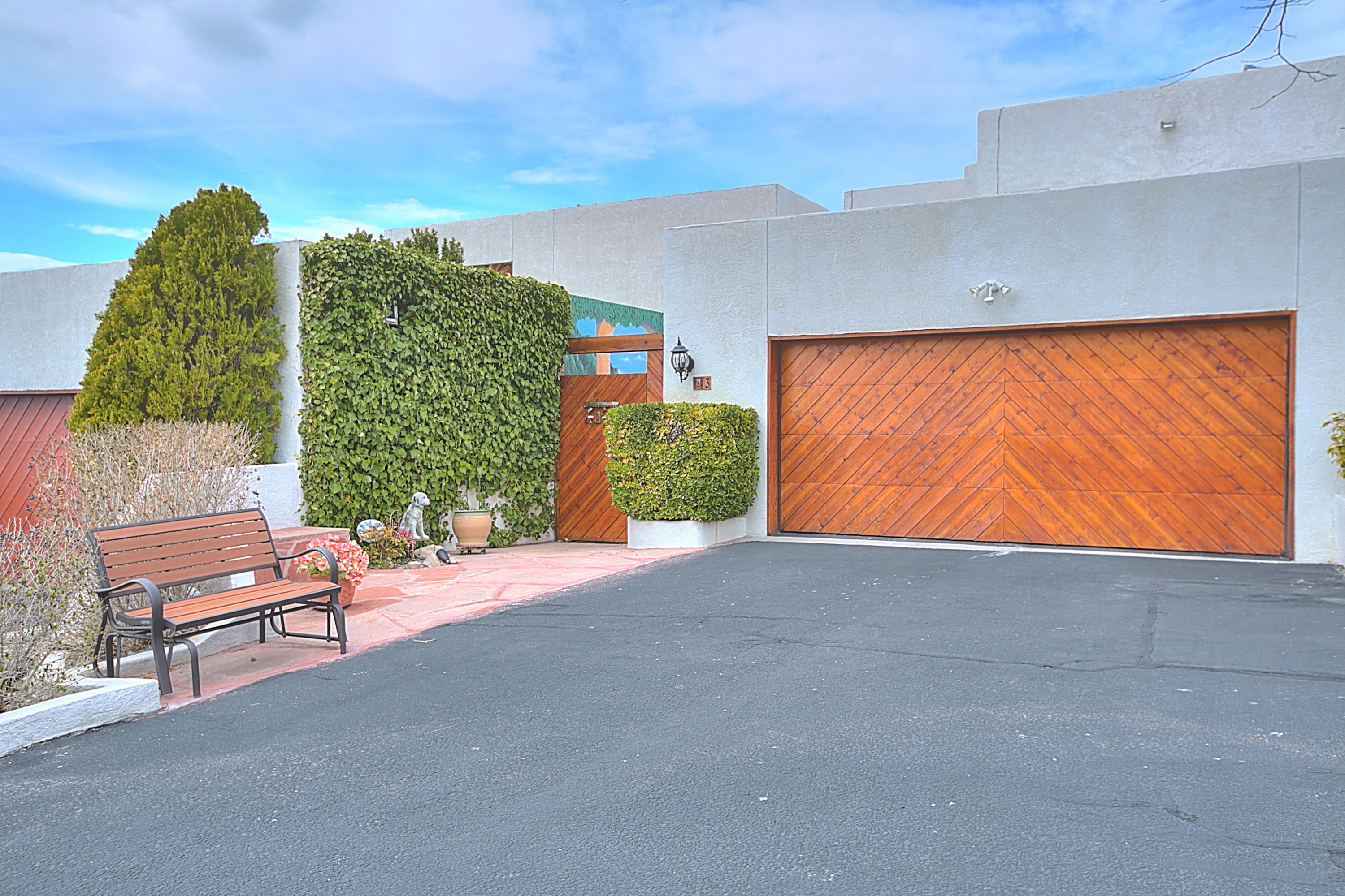 This custom split level townhouse is located in the desirable Foothills and is ready to call home. The moment you walk through the private entry courtyard, you can't help but notice the beautiful artwork that makes you feel like you're in another city. As you enter the home, your eyes draw you to the custom gourmet kitchen that includes granite countertops and endless cabinet space, a kitchen perfect for entertaining guests and a cook's dream. Home also features, a wood burning fireplace, tile and wood floors, refrigerated air, office off of the master, balcony, spiral staircase to upstairs bedroom, raised ceilings, custom master bathroom, and much more. This home was well thought out when remodeled and nothing was left out. A visit to this home will allow you to see it's beauty.