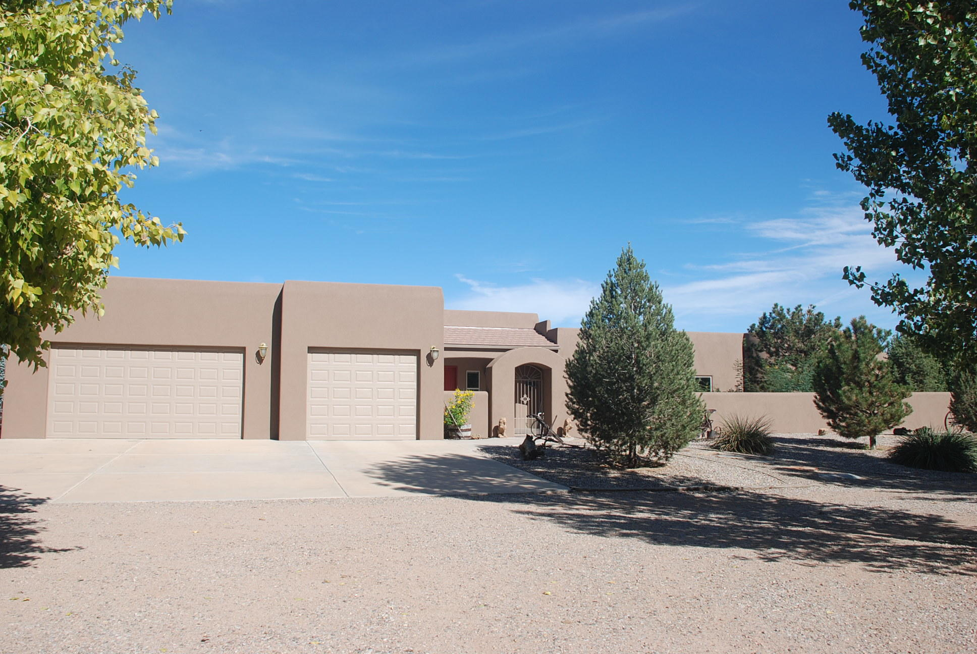Gorgeous Hacienda. Beautiful Santa Fe Style Home Custom built for Current Owner. No  attention to detail has been spared. Spacious Rooms, Multiple Patios with Wonderful Views, Irrigated Pasture. Attached Garage Plus Detached Workshop with Additional GarageSpace. Well Located on 3 plus  irrigated acres in well established  Rural Area. Be advised:  Advance Appointment is Necessary to See this Property. Click on lower corner of second photo for virtual tour.