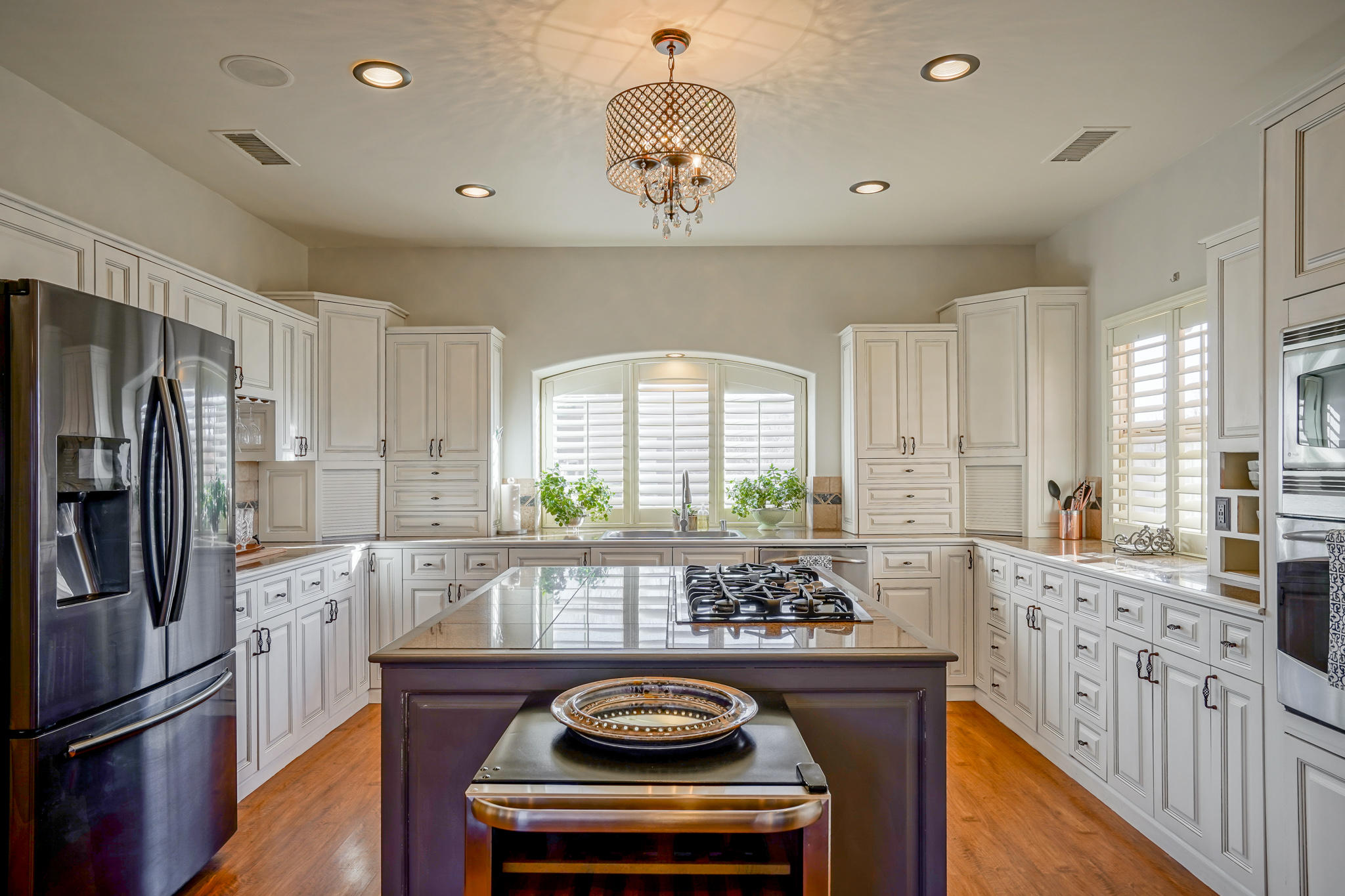 Elegant custom two story home on 1.03 acres! Wood beamed Ceilings, Three fireplaces and lots of high end finishes are just a few of the must see details your new home has to offer!  Step into the private courtyard perfect for outdoor dining or lounging with friends. The stunning kitchen is a chef's dream with gas cooktop and large kitchen Island!  There is even a Butler pantry! Huge master suite with updated bathroom and large deck for viewing the Sandia Mountains. Soak in the Jetted tub in the Master bathroom as you wash away your day next to a gas log fireplace. Two rooms down stairs share a beautiful Jack and Jill full bath with dual sinks. Take a Virtual Walkthrough tour today! Hurry! This one wont last long!