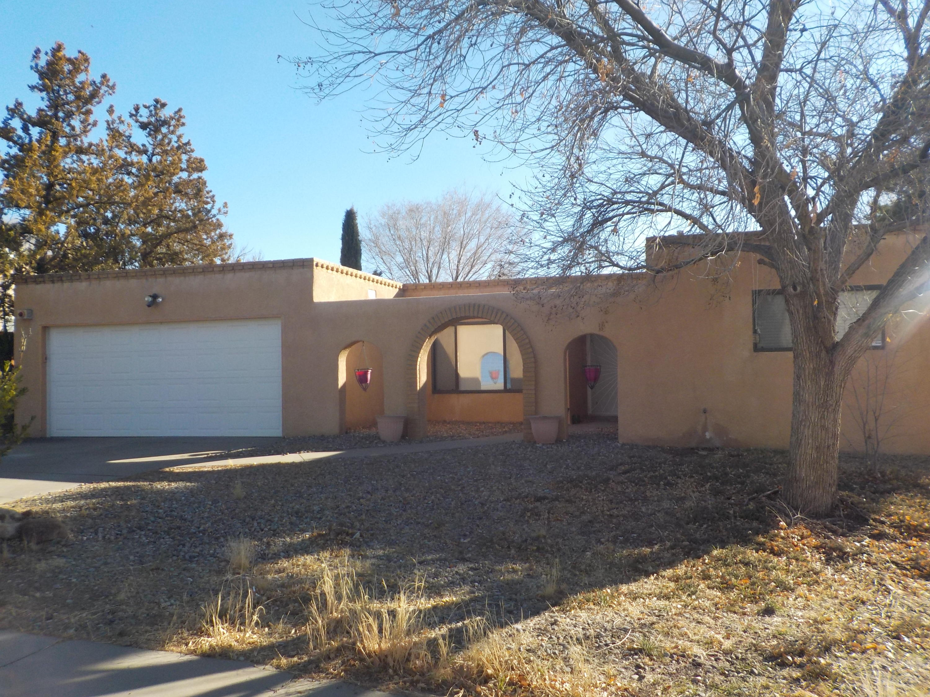 Beautiful home that features 4 bedrooms and two baths. Two living areas, fireplace and a sunroom that opens to a nice backyard. Home has a newer roof.