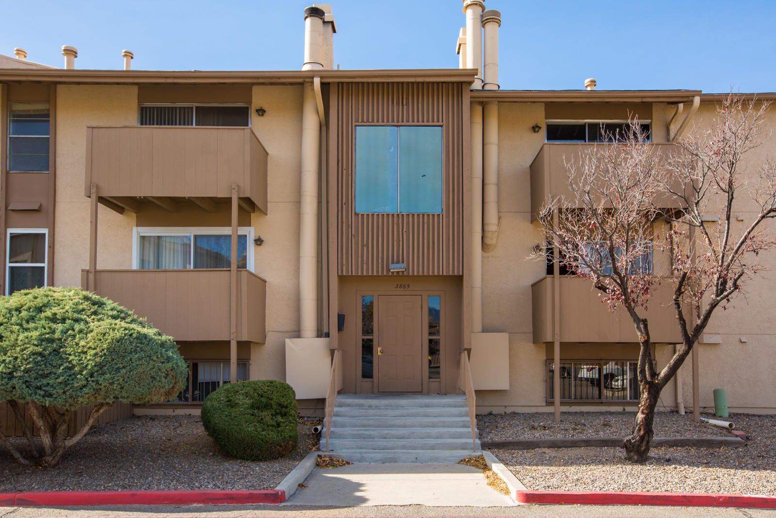 Welcome Home to this Bright, Beautiful, Single-Level, Ground-Floor Condo with 2 Spacious Bedrooms, Walk-in Closets, Tile + Newer Laminate Flooring throughout! No Carpet. *Refrigerated Air!* Let a Cozy Wood-Burning Fireplace be your Living Room's Focal Point! HOA Covers 24-Hour Security, Pool, Hot Tub, Sauna, Gym/Equipment, Clubhouse, Playground, gas, water, sewer, and trash. Separate Storage Unit for Owner just across the hall. Gated Community. Convenient Location w/ Easy Access to Everything. Make an appointment to see this Home today!